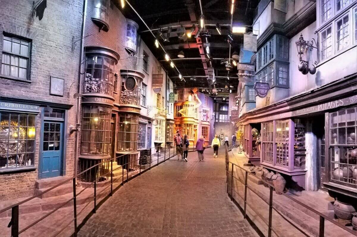 The set of an old street with stone buildings on either side inside of a building at the Warner Bros Studio Tour London, one of the most popular half-day trips from London.