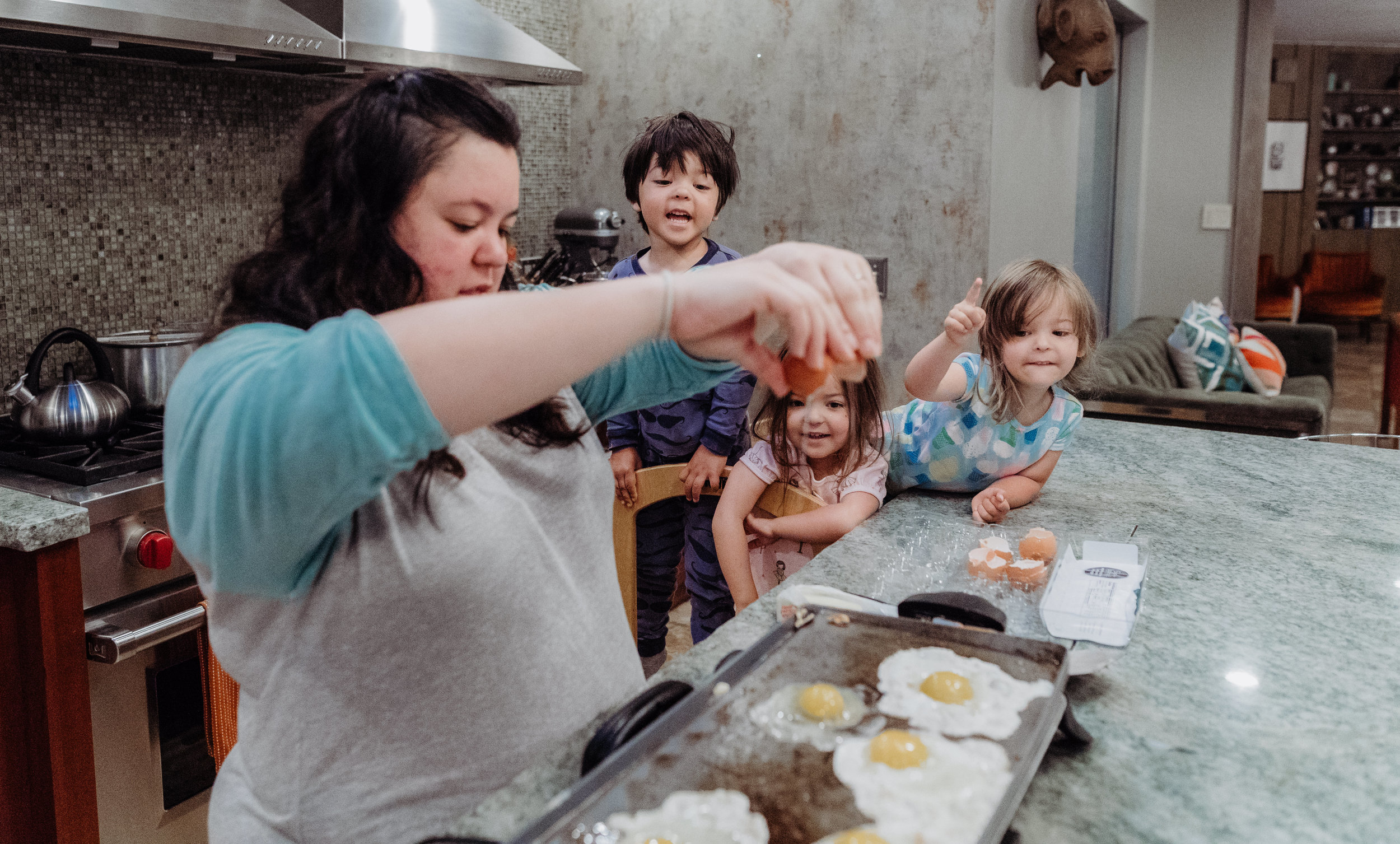 documentary lifestyle family photo session kids helping mom bake in kitchen Ore Adesina Photography Oklahoma City