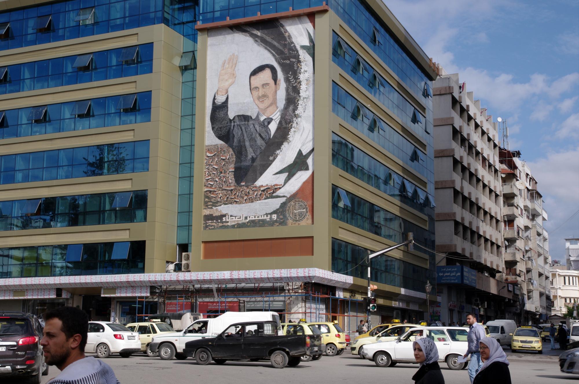 A mural of Bashar al-Assad in the port city of Latakia, Syria ( source )