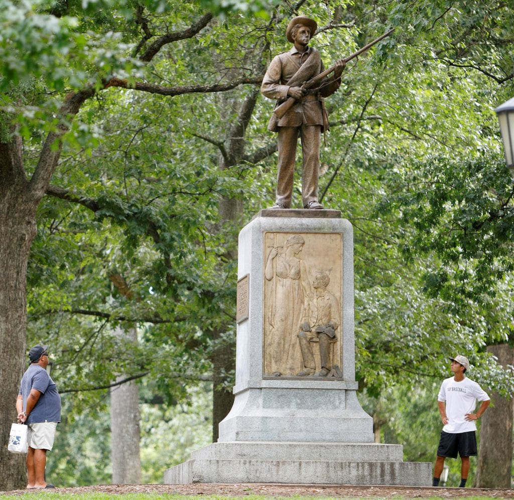 The Silent Sam monument before it was removed earlier this fall ( source )