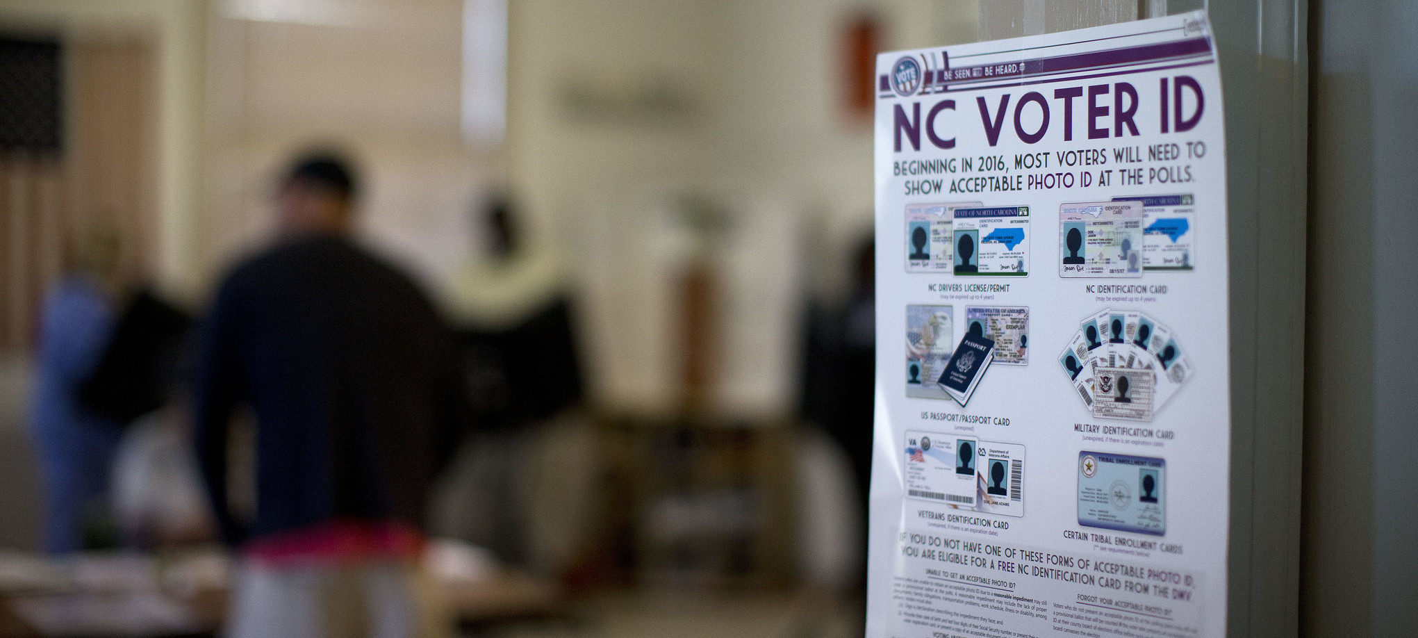 A poster listing voter identification requirements at a North Carolina precinct ( Image )