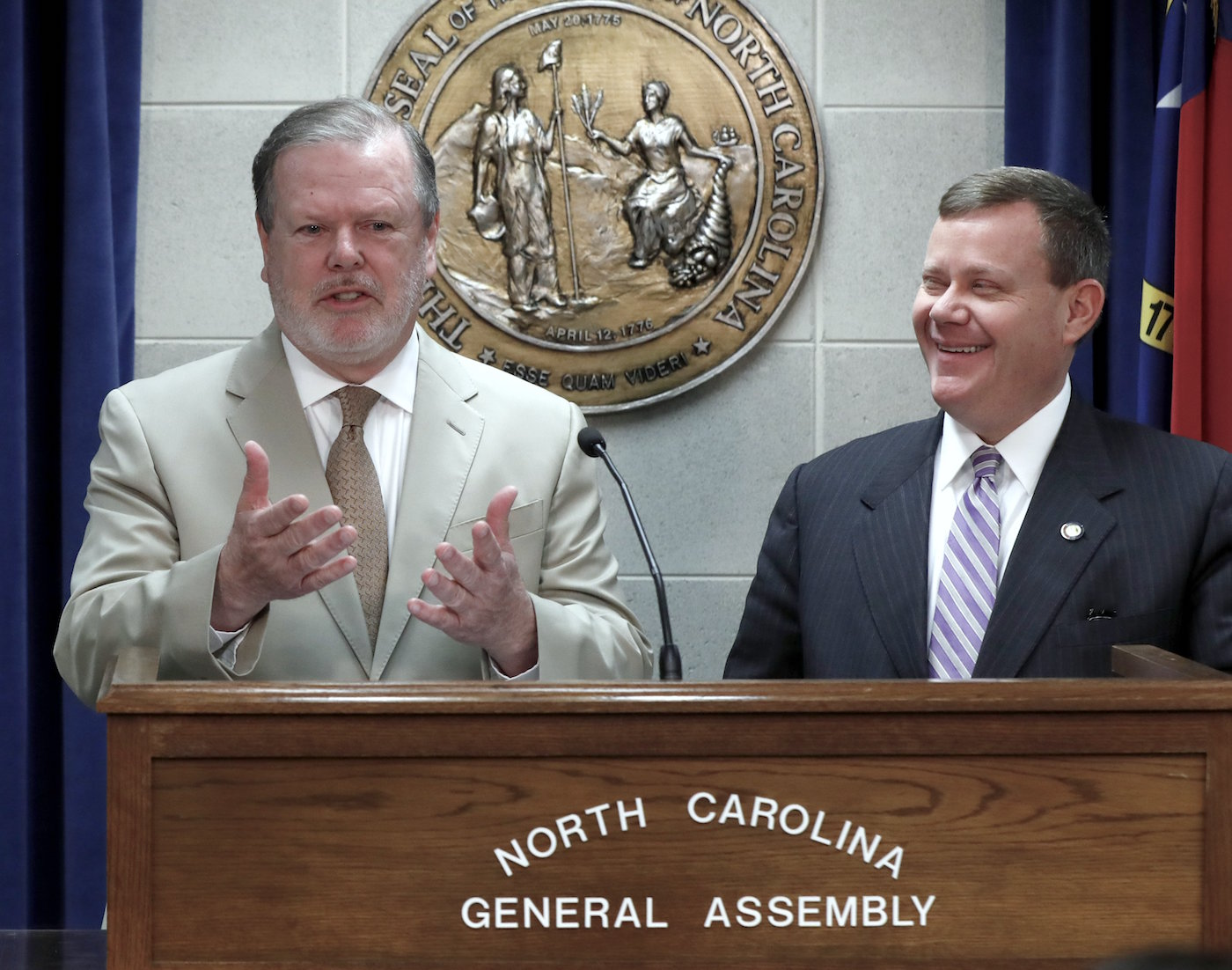 State Senate President Pro Tempore Phil Berger and House Speaker Tim Moore at a press conference in May ( Image )