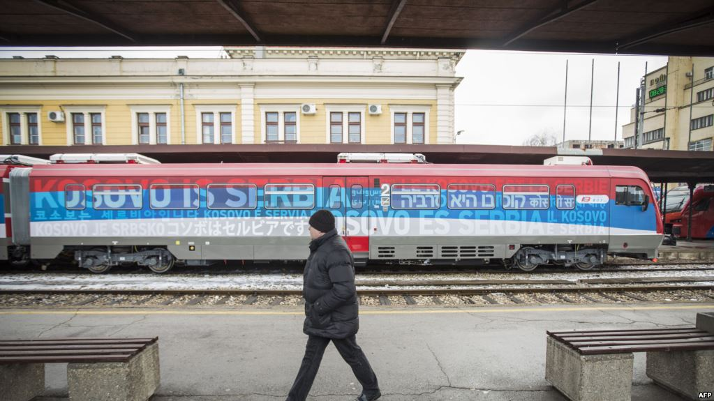 """A Kosovar train with graphics asserting """"Kosovo is Serbia"""" in 21 different languages ( Image )"""
