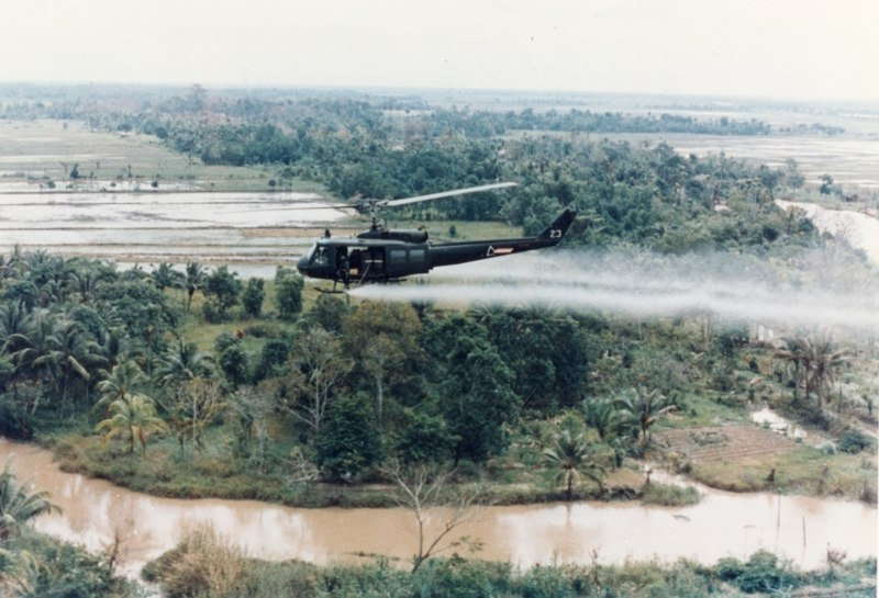 An overview shot of a US Helicopter spraying Agent Orange in Vietnam ( source )