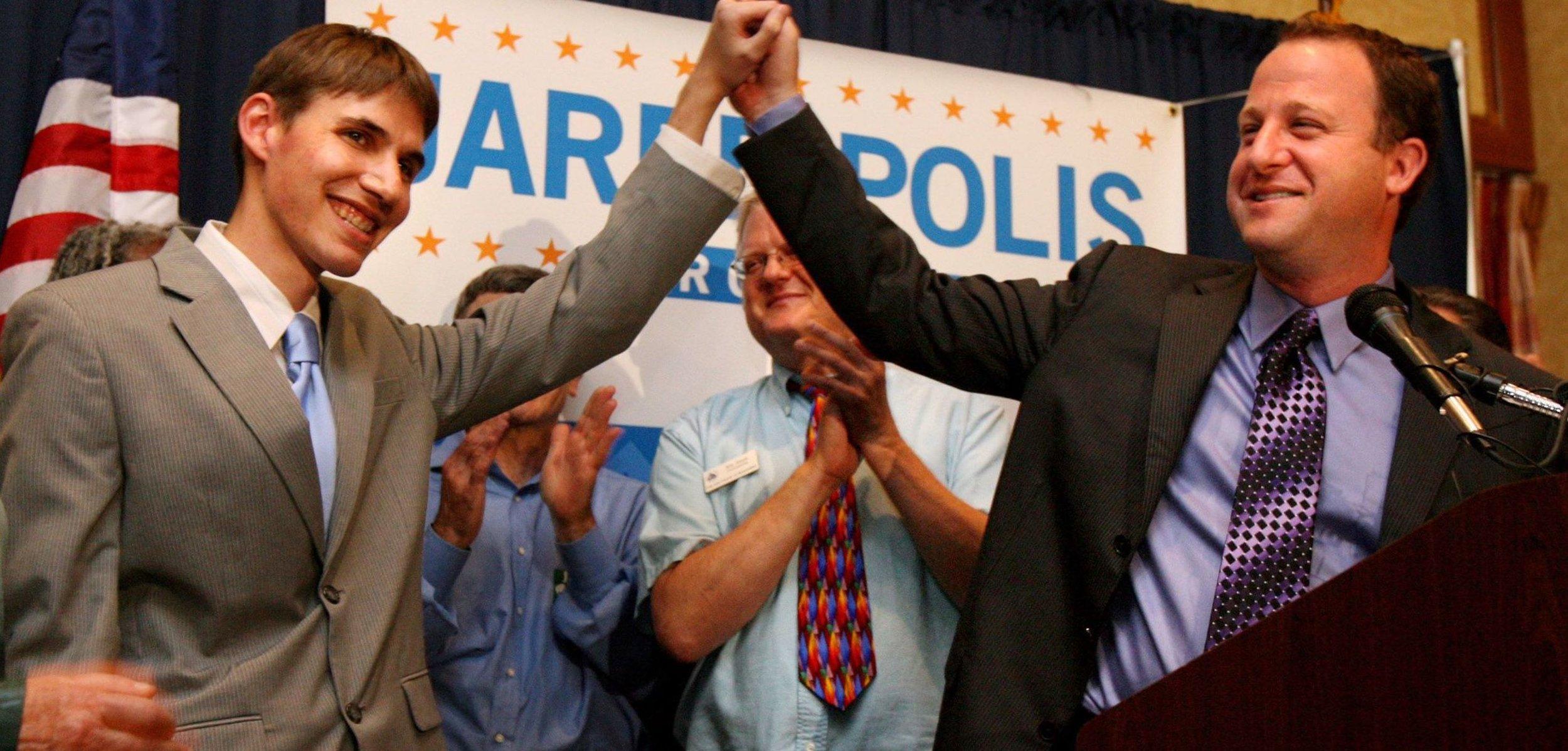 Jared Polis, who became the first openly gay governor on November 6th, with his partner Marlon Reis ( Image )