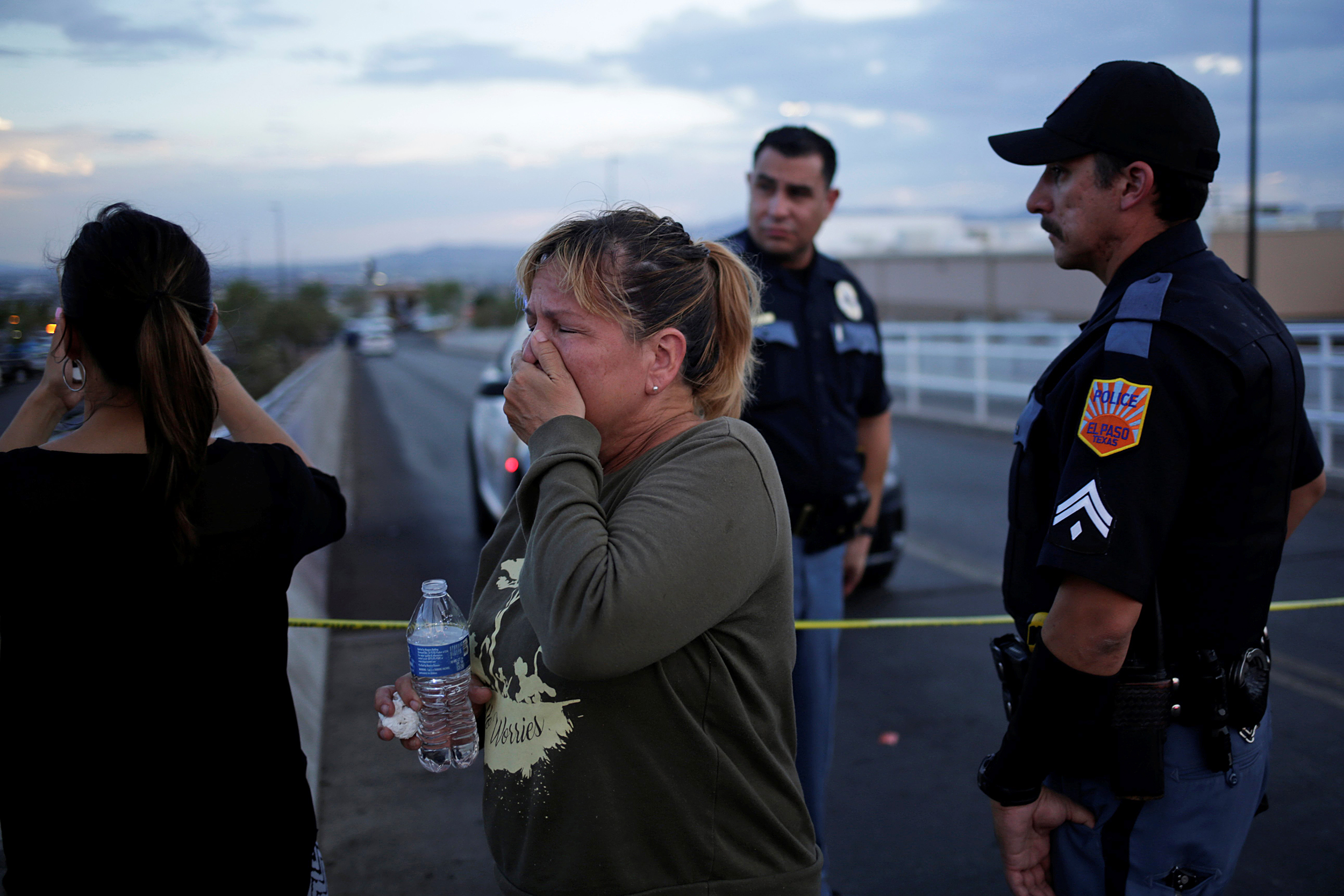 Onlookers stand outside an El Paso Walmart, where a gunman killed 22 shoppers in August ( Image )