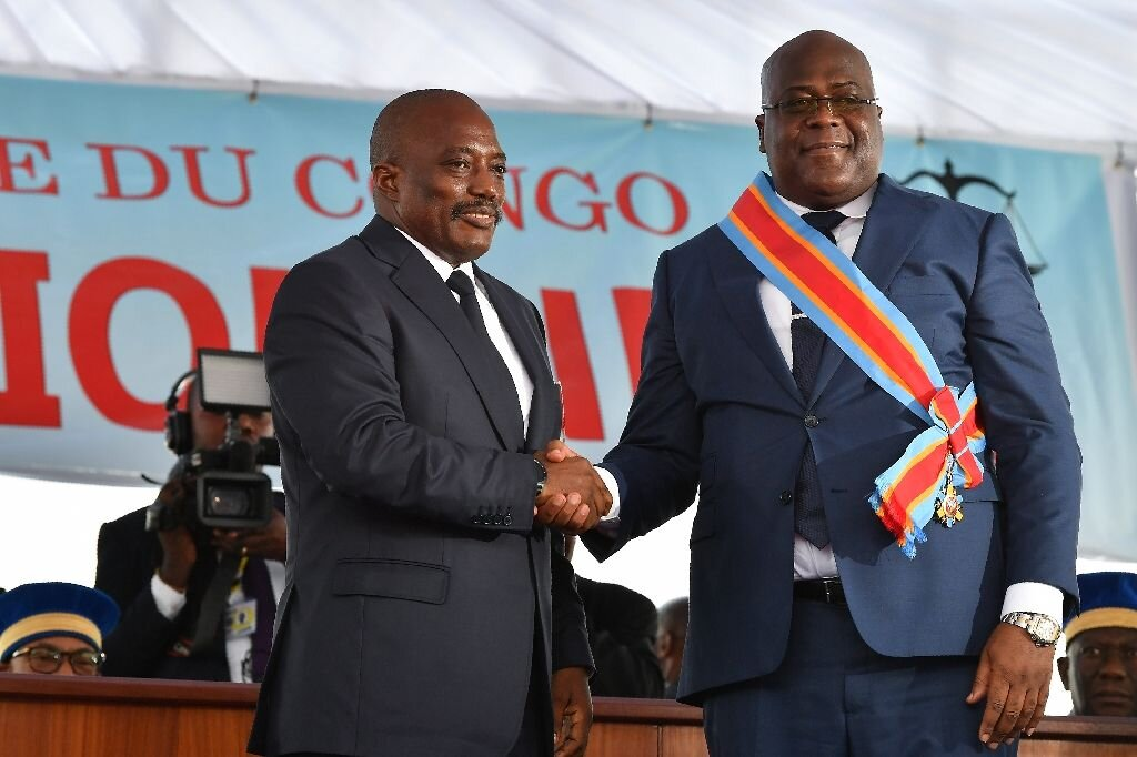 In the DRC's first peaceful transition of power, Felix Tshisekedi (right) succeeded Joseph Kabila (left) as president ( Image )