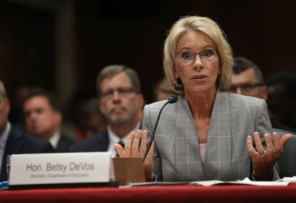 The U.S. Department of Education, headed by Betsy DeVos, threatened to withdraw funding for the consortium ( Image )