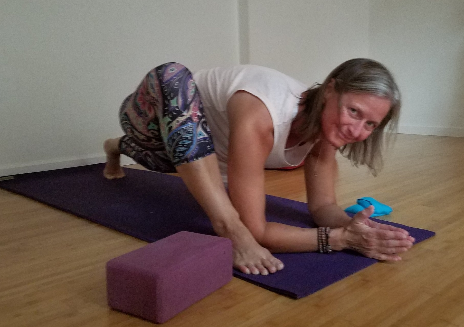 Lizard pose can be modified by dropping the back knee to the ground and/or staying long through the arms rather than lowering to the elbow. Options to play with include the knee slightly out away from the mid-line, or hug close to the shoulder