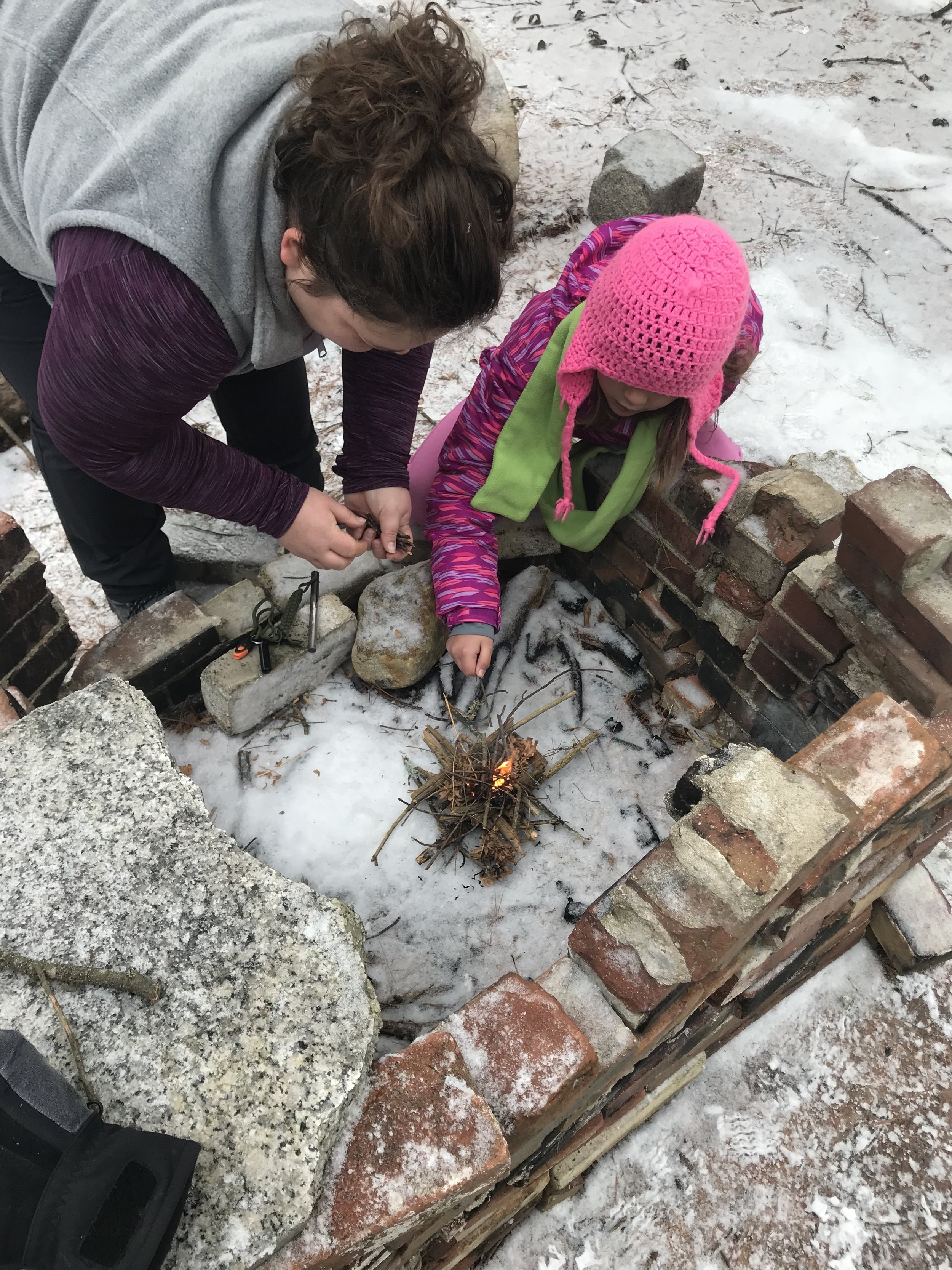 Testing our fire building skills in an abandoned fireplace.