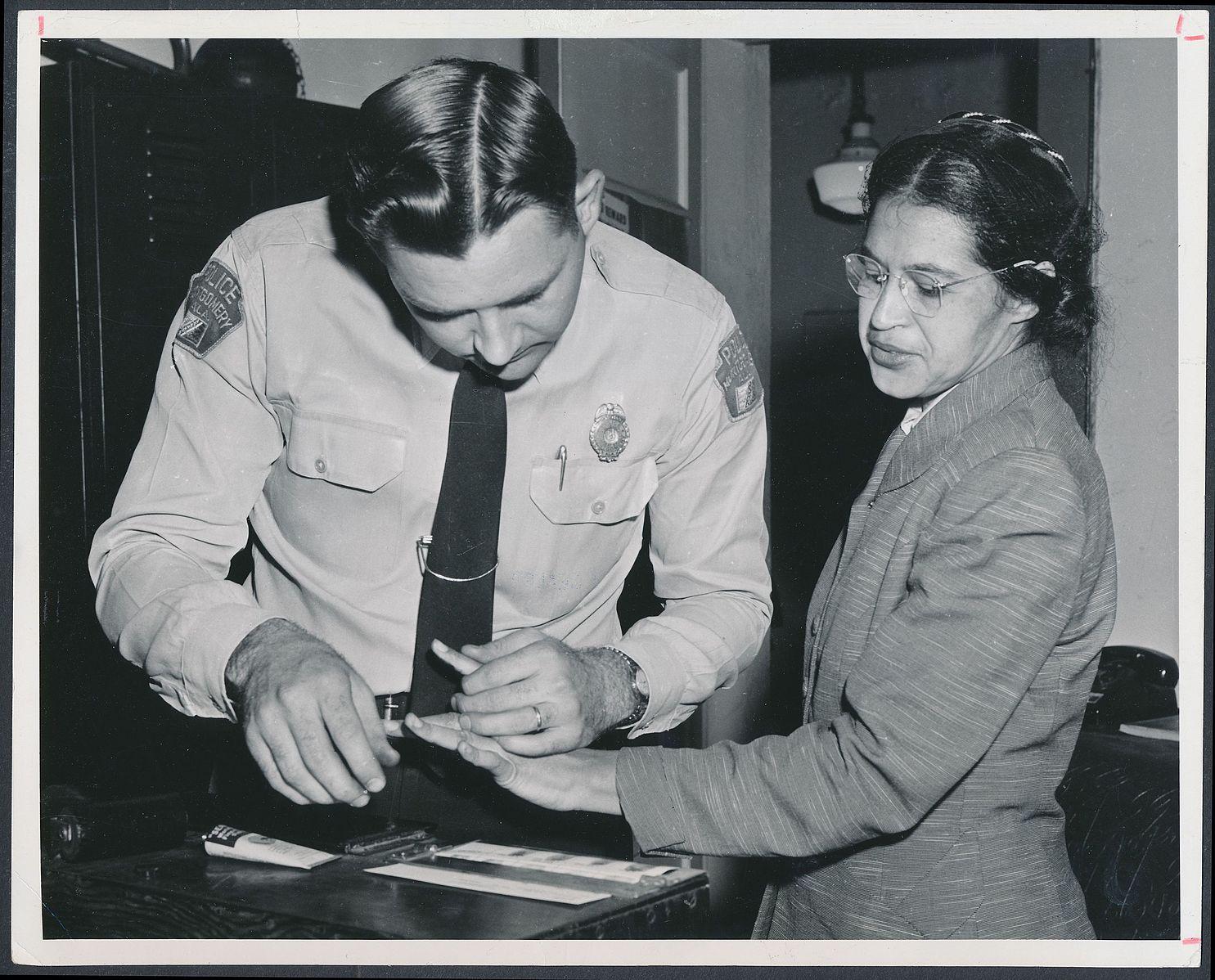 Rosa_Parks_being_fingerprinted_by_Deputy_Sheriff_D.H._Lackey_after_being_arrested_for_boycotting_public_transportation_-_Original.jpg