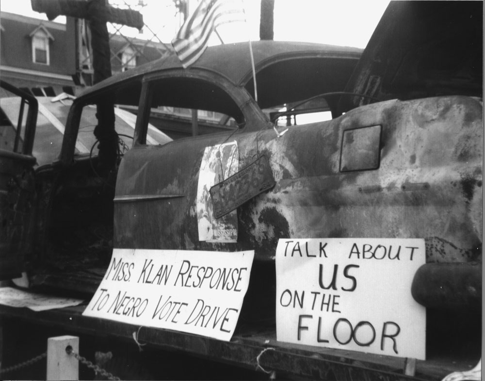 The MFDP brought this car to Atlantic City to show the delegates and press at the Democratic Convention how Mississippi blacks were treated when they tried to register to vote. © 1964 Jo Freeman