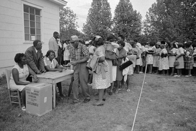 African Americans cast ballots for seven nominees of the Lowndes Country Freedom Organization in Hayneville, Ala. on May 3, 1966. Photo by Horace Cort/AP.