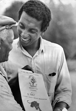 Stokely Carmichael talks with a Lowndes County resident.