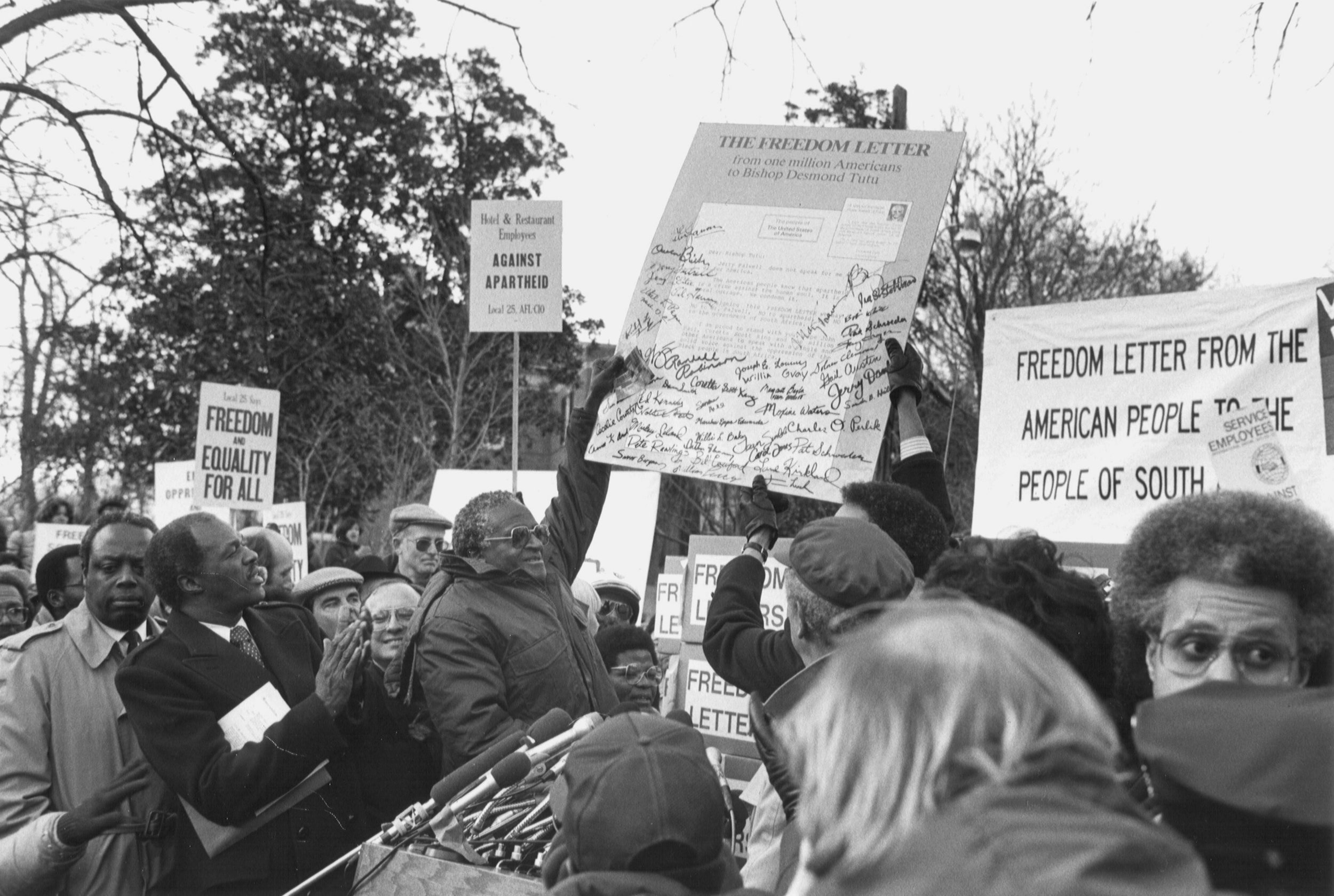 Bishop Desmond Tutu acknowledges receipt of more than 1,000,000 freedom letters on January 8, 1986 outside the South African Embassy in Washington, D.C. Photo (c) Rick Reinhard.