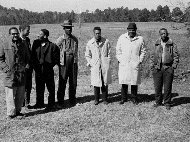 1963, Mississippi Voter Registration Activists (l-r) Bob Moses, Julian Bond, Curtis Hays, unknown activist, Hollis Watkins, Amzie Moore, and E.W. Steptoe. Photo (c) Harvey Richards Media Archive. Click on image to learn more.