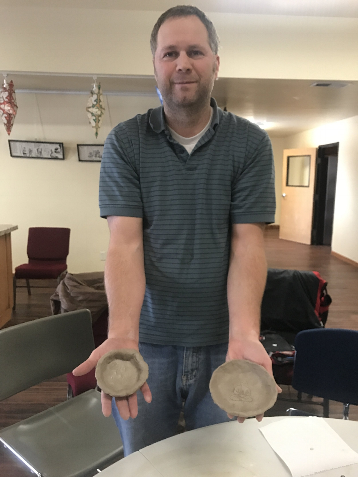 ARTS Participant - David Packer, CBRS Worker and Case Manager shows off his very first pottery pieces.