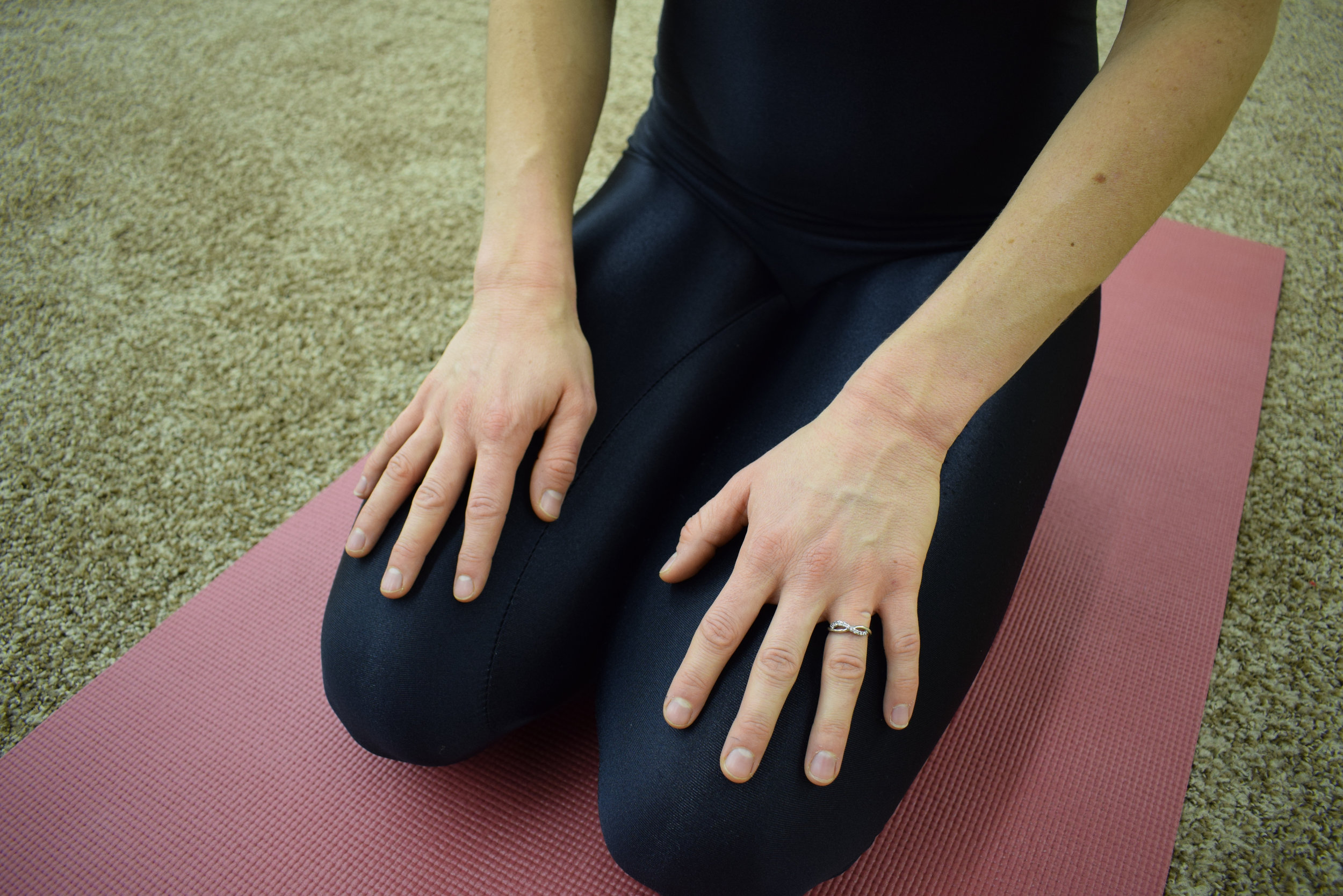 Figure 1: Bring the light of your awareness to your wrists in Hero Pose