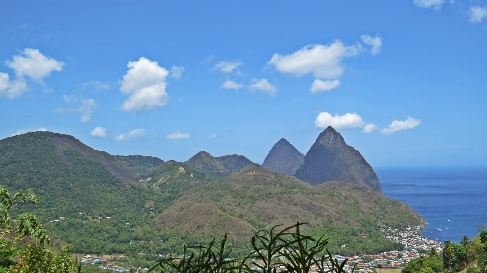 The volcano is in the very left of the picture - the dome with black rocks running down the right side.