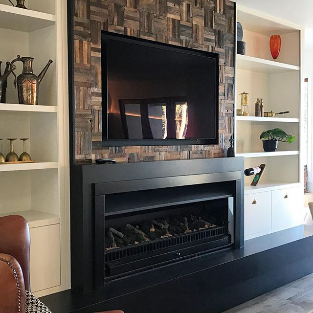 Fireplace with chimney clad in recycled selvedged timber. Bespoke Cabinetry, another great finish by @matakanakitchenandjoinery #artifexflooringnz #realfiresnz #boardandbattendesign #matakanakitchensandjoinery #interiordesign #interiordesigner #fireplacedesign #bespokecabinetrydesign Hearth stone #touchstonematakana