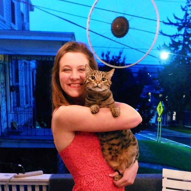 """We're less than one week away from graduation, which means it's time for another spotlight: Caroline Dodd (and her lovely cat, phoebe)! . Voice Part: S2  Major: Environmental and Sustainability Sciences Hometown: Saranac Lake, NY Fave chorus song: Audivi Vocem de Caelo Venientem . Outside of the chorus, Caroline is a member of Flute Choir, Big Red Marching Band, Cornell Running Club, and Youth Climate Advisory Board. She is also the captain of the Nordic Ski Team, and she teaches paddling for Cornell Outdoor Education. . After graduation, she will be working on a youth climate education initiative at The Wild Center in the Adirondacks and later travelling to Europe with friends. Afterwards, she will be studying the LSAT and applying to law school for environmental law. 🌳💙 . """"I will miss the uniquely wonderful opportunity to share meaningful musical experiences with such impressive and lovely individuals."""" . The chorus is going to miss you so much, Caroline! You are such a ray of sunshine and we love your passion for the environment! Don't forget that your chorus family is always here for you ❤️🎵 . #cuchorusseniors19 #choruslove"""