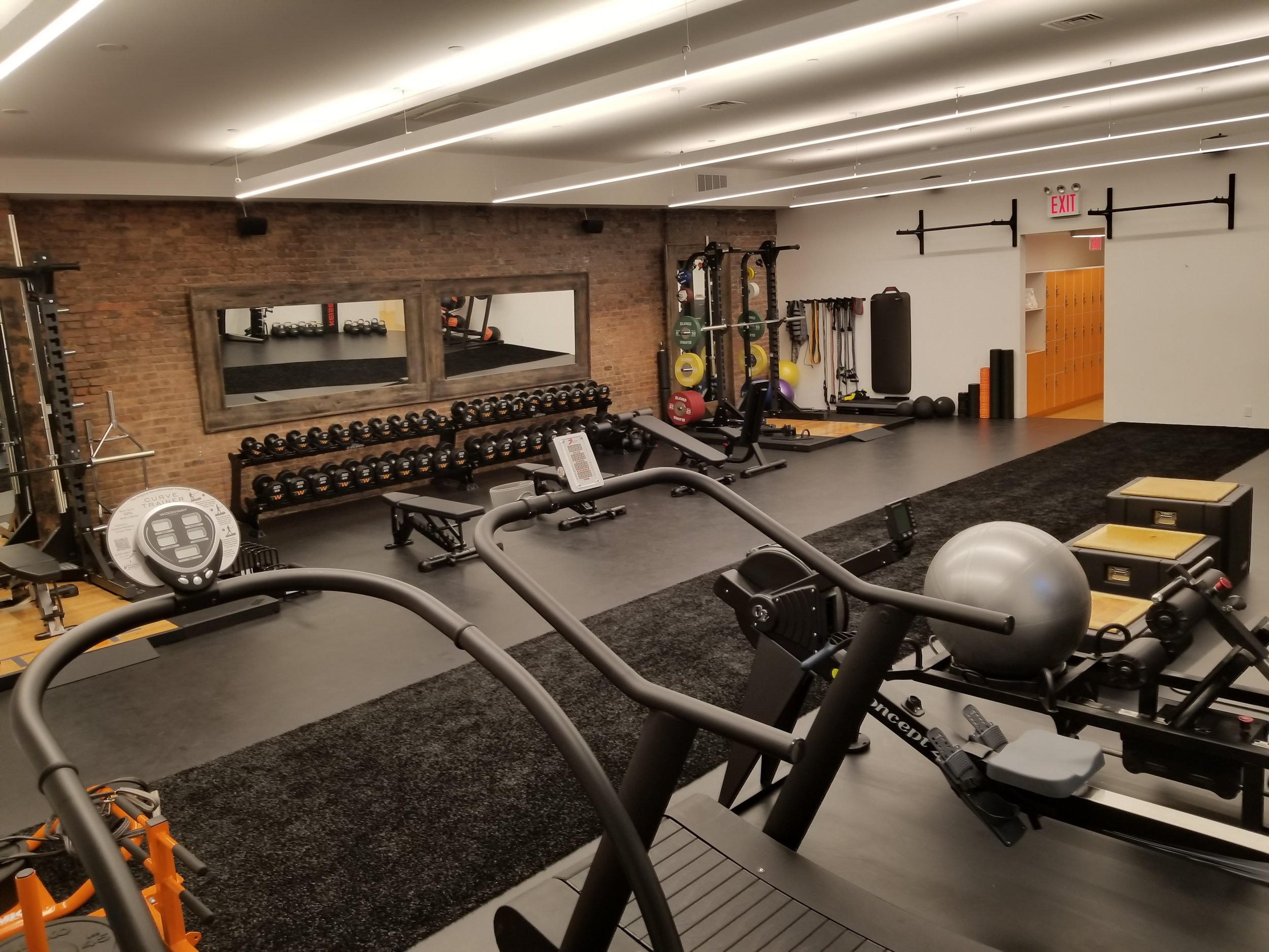 Our private training facility in partnership with TWF in Manhattan's Chelsea neighborhood has full towel service and shower facilities as well as top of the line equipment.