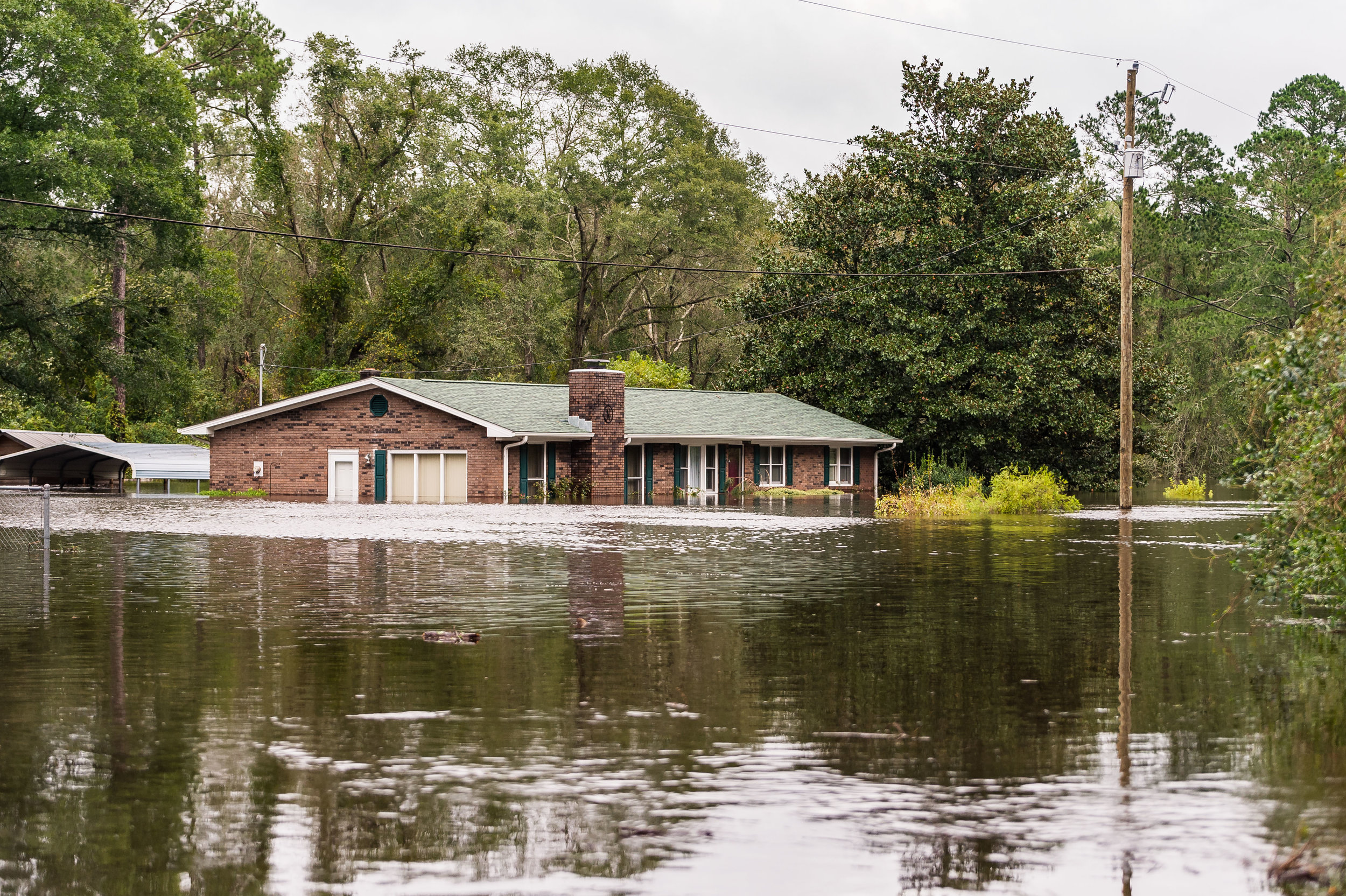 September 16, 2018, Pollocksville, NC- Trent Acres Drive covered by rising flood waters.
