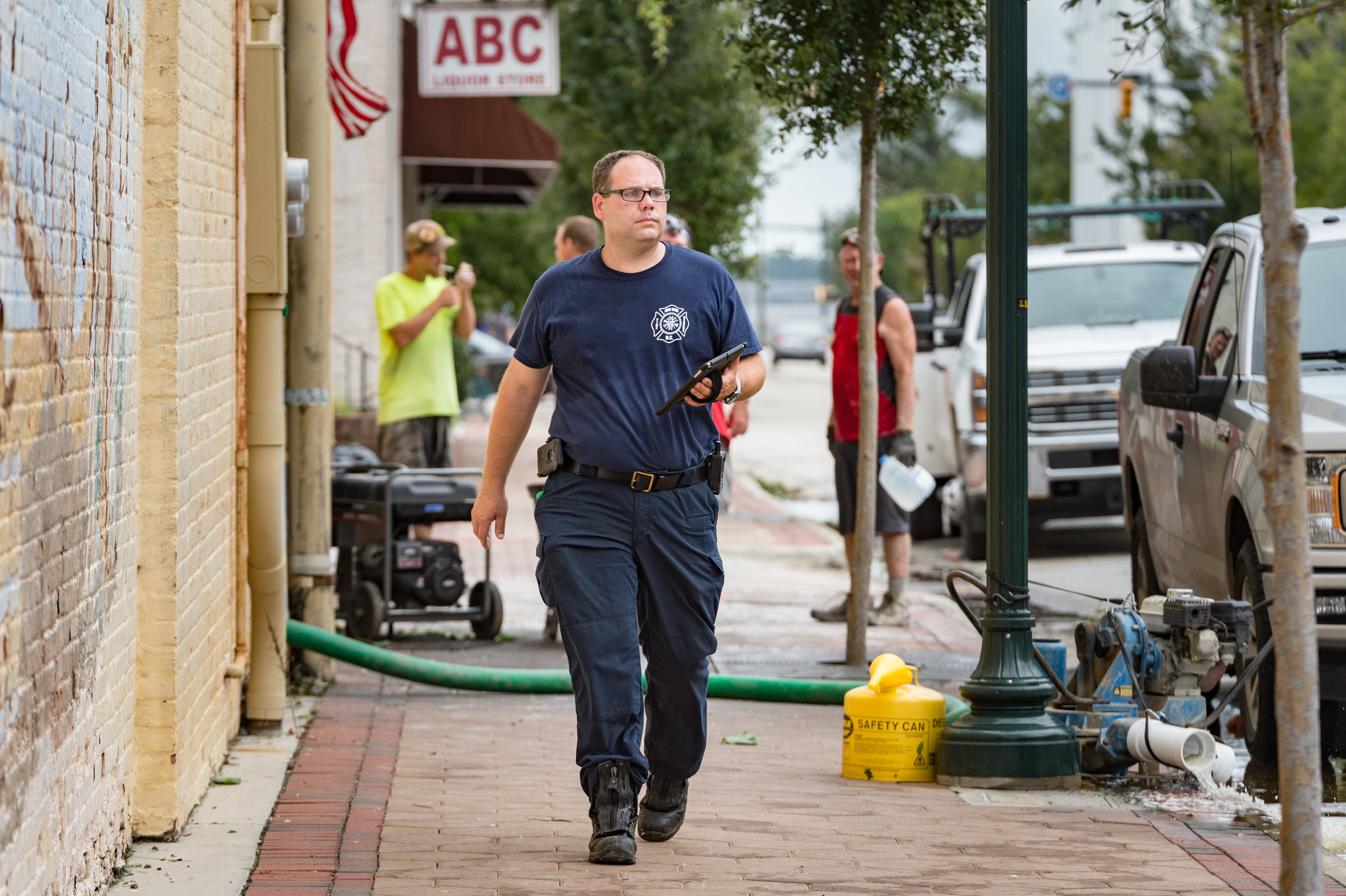 September 16, 2018, New Bern, NC- A New Bern firefighter is conducting a damage assessment.