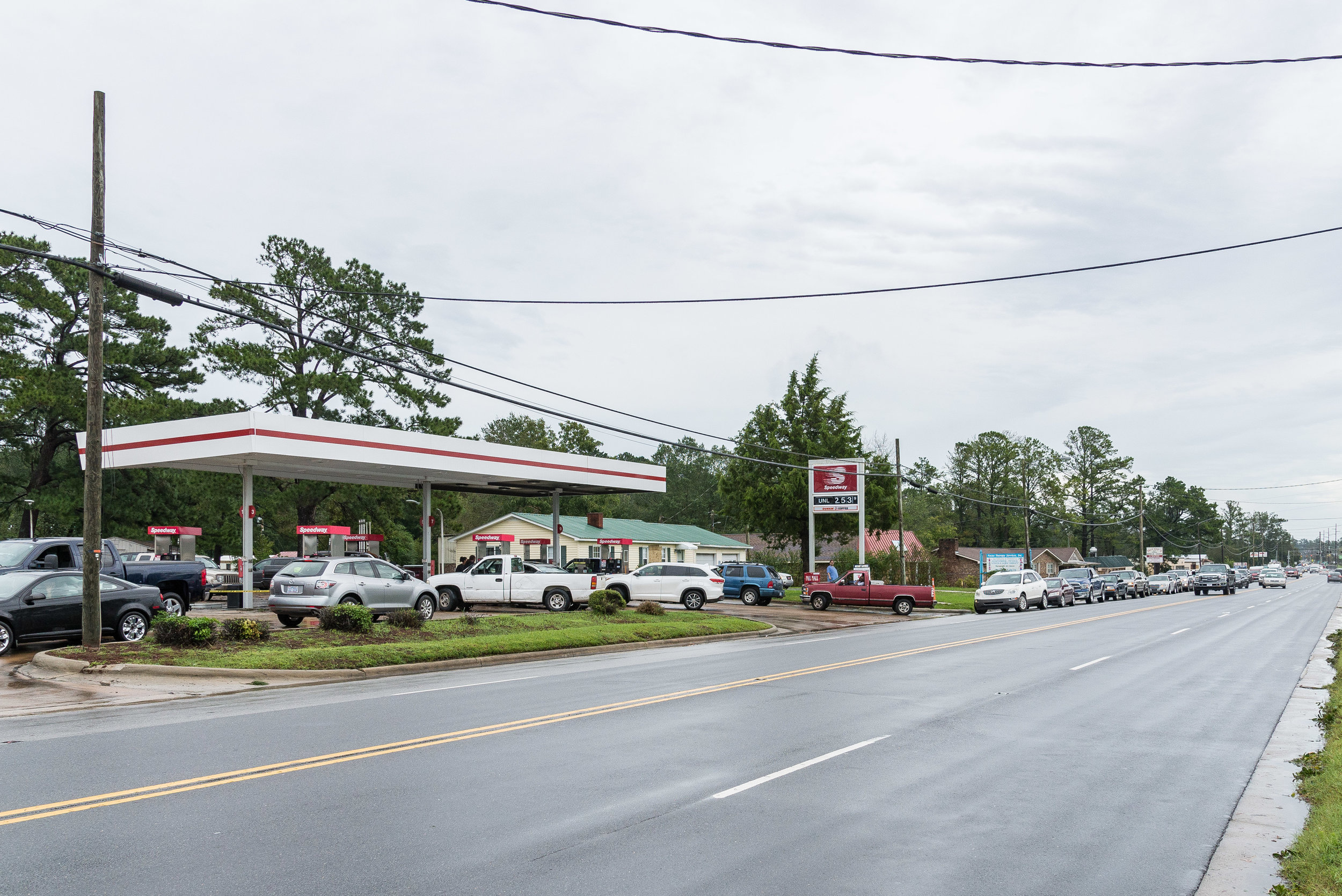 September 16, 2018, New Bern, NC- A line over a half mile long is seen at a Speedway Gas station. The only station in the area that had both fuel and power.