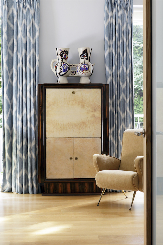 Mortell sourced the 1920s macassar secretaire with parchment front in France