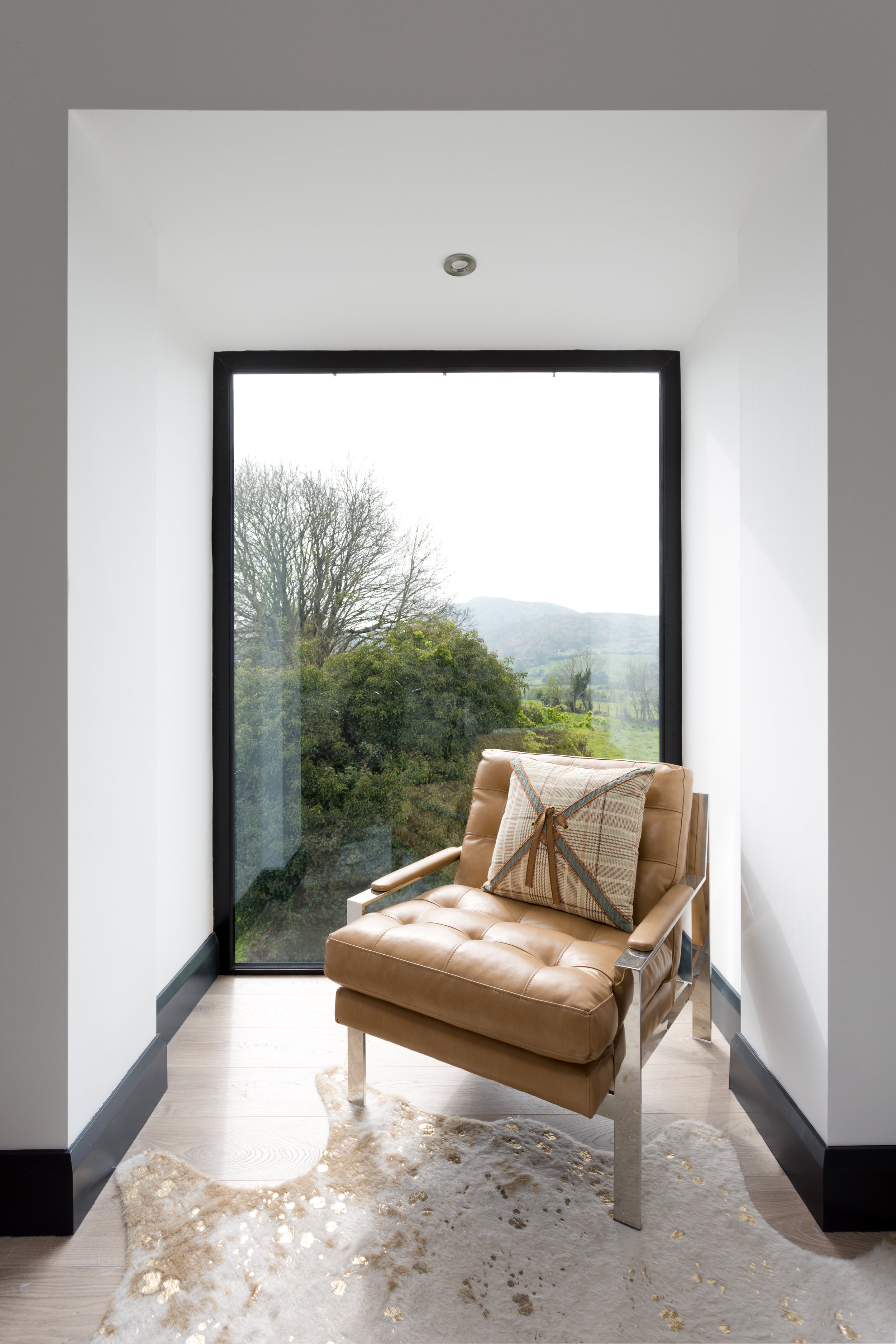 This bedroom window creates a nook to sit and enjoy the view.