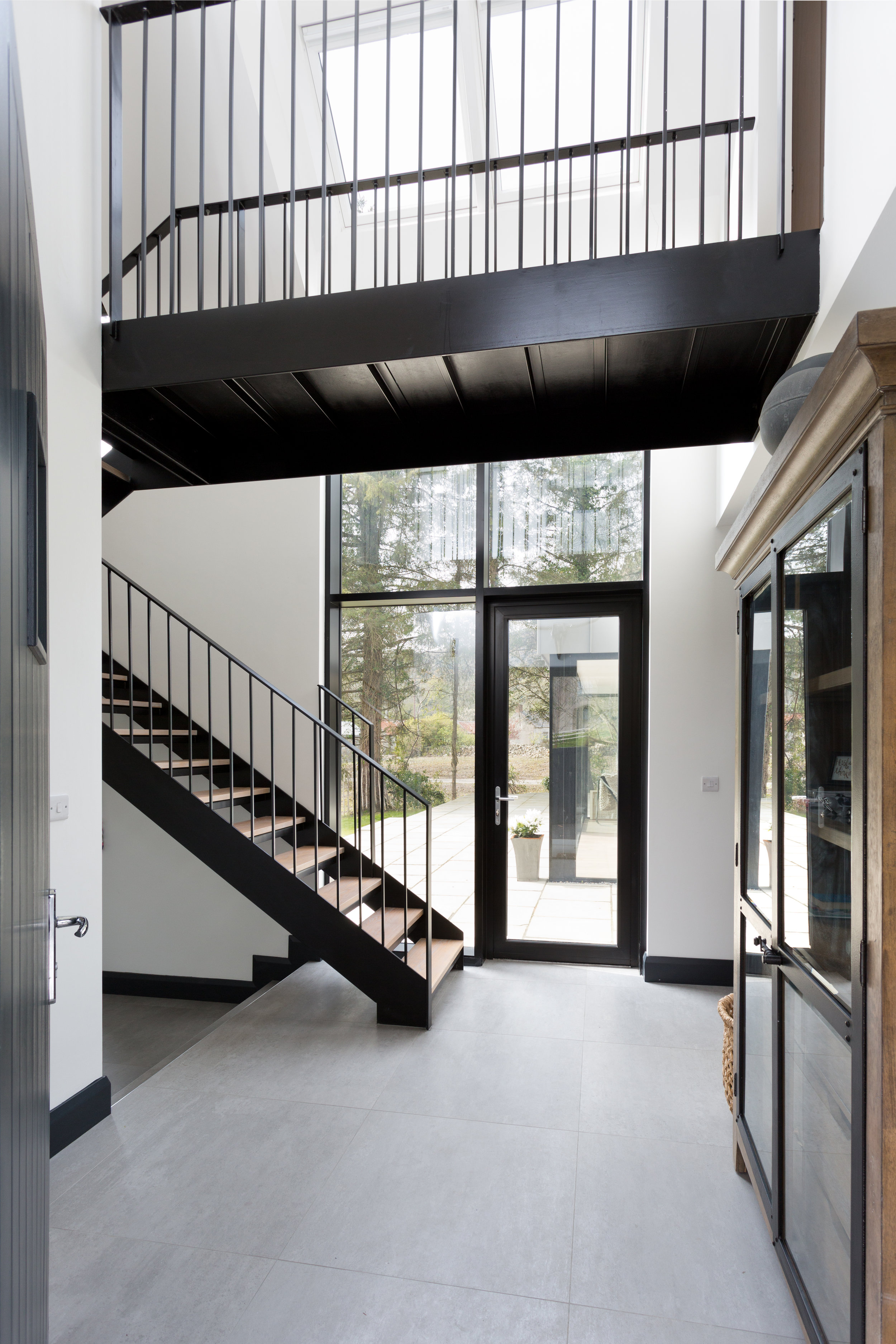 The open staircase allows light to flow through the house.