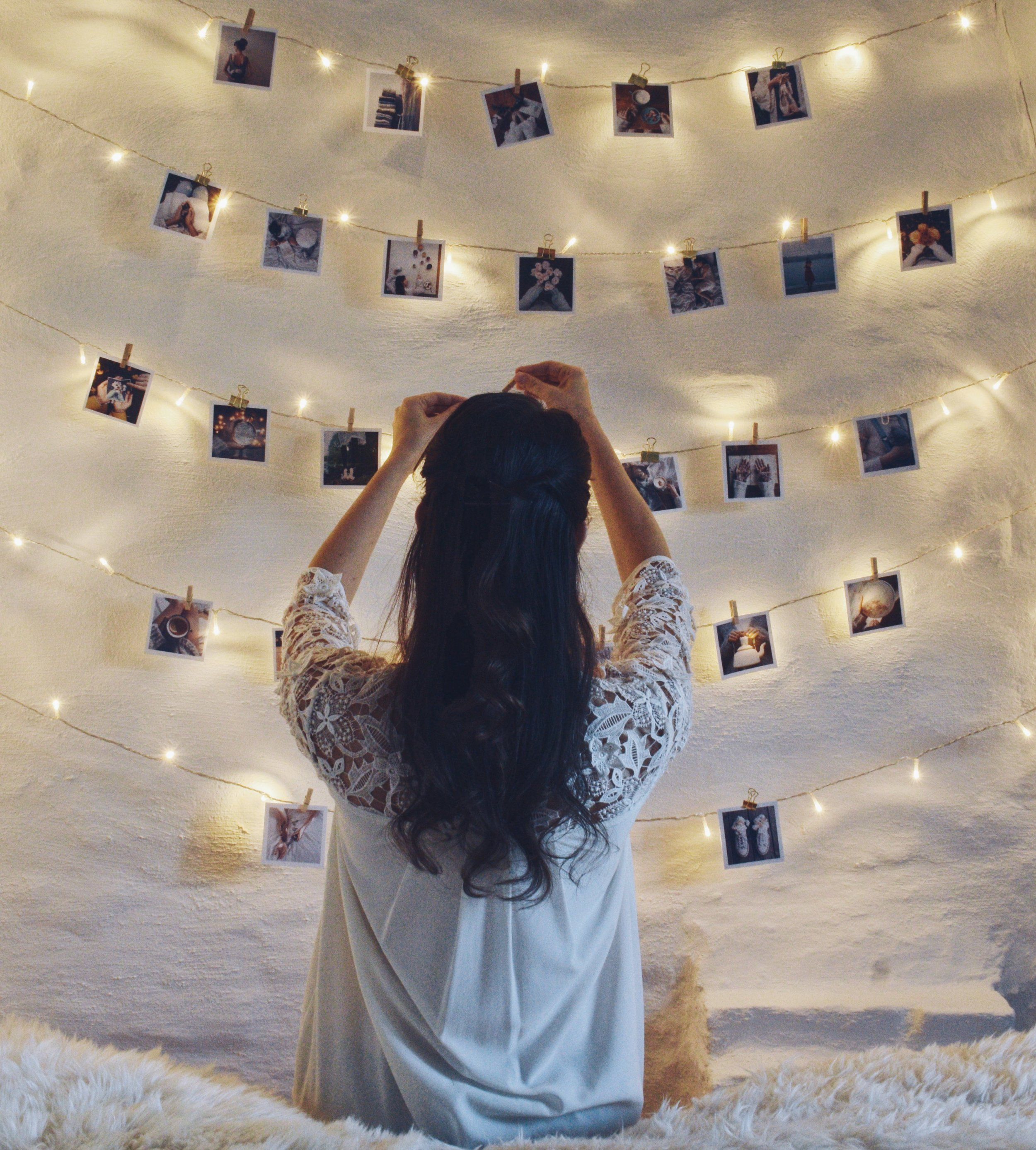 Fairylights and polaroids on a white wall