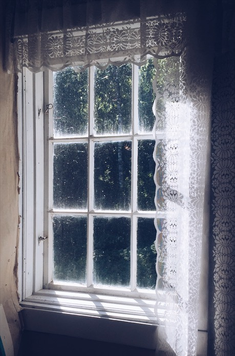 Photos from the Archive-  Celebrating the Imperfect. An old window with a bit of sunshine coming though