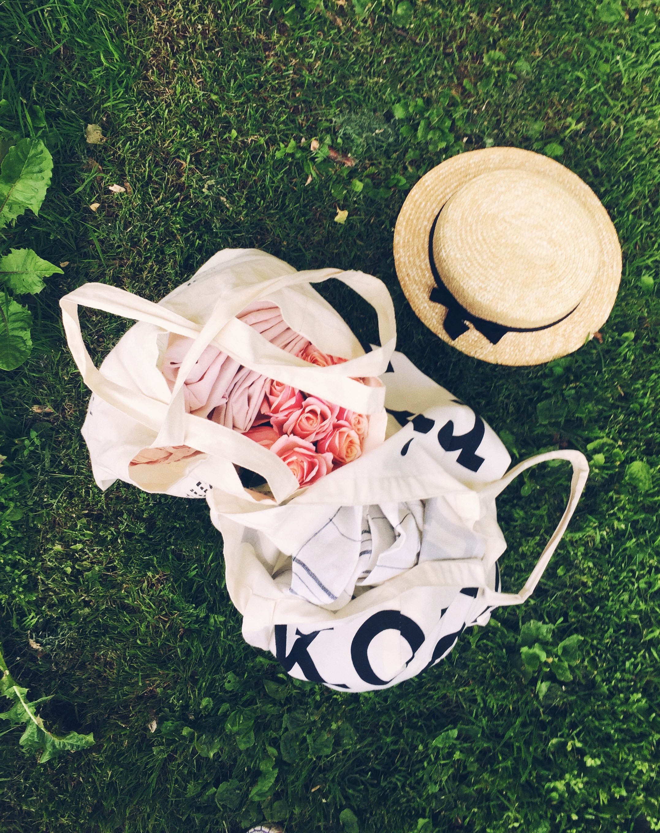 5 ways to cope with Summer restlessness- picnic and sun hat in the grass
