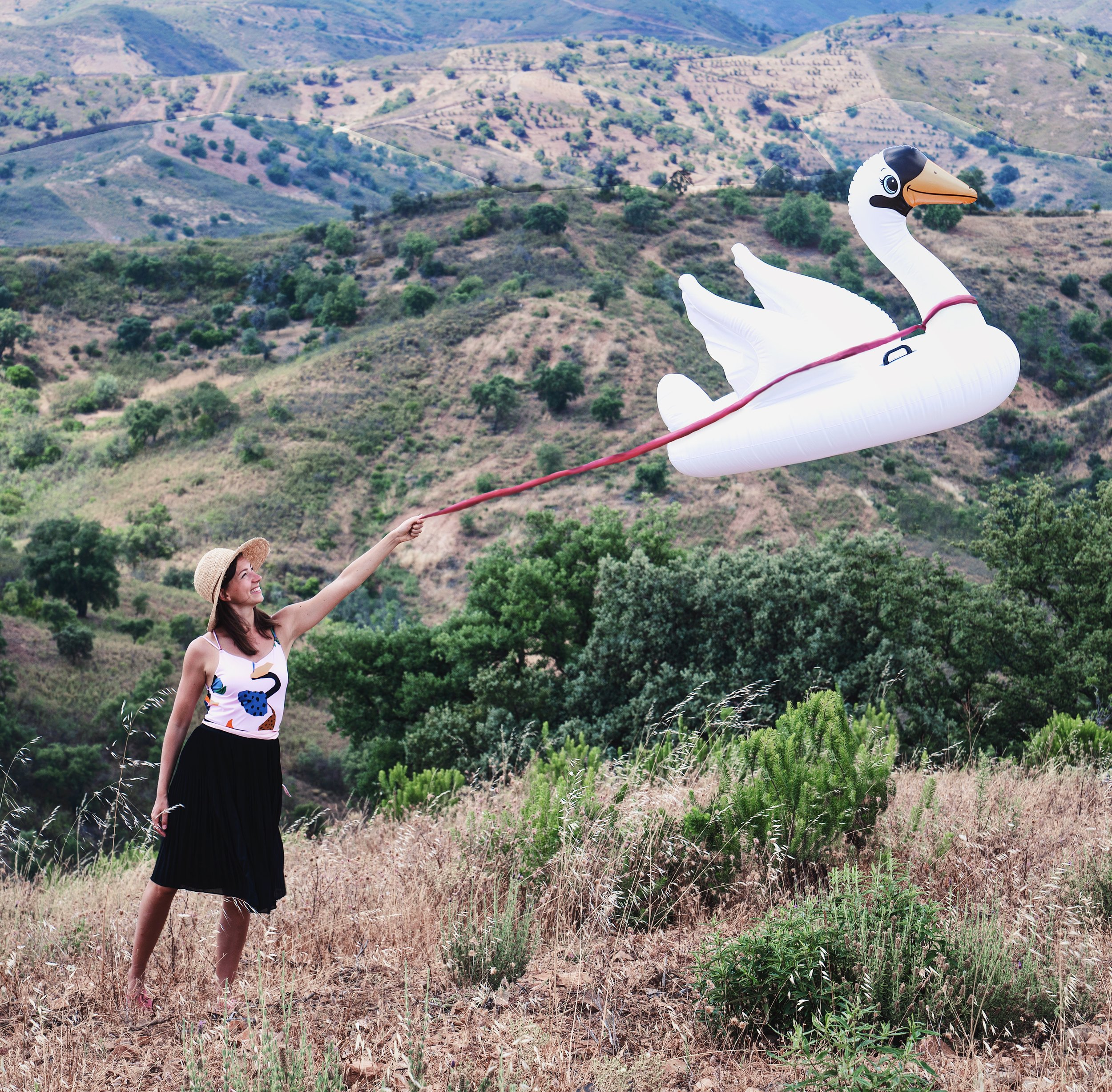 Fun Self Portrait Ideas- Flying inflatable swan in the hills