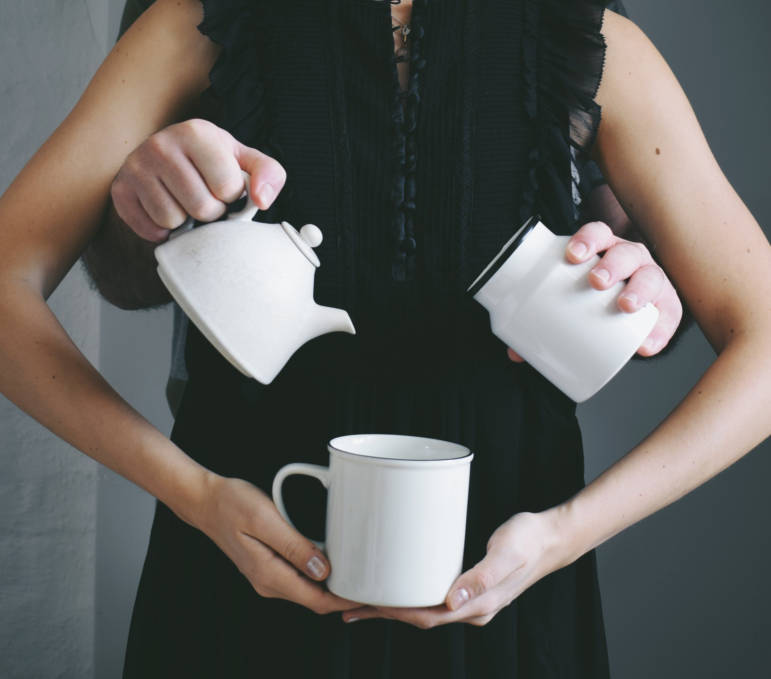 Yhings i'm excited about for Fall- Stronger relationship, poring coffee in my cup with a pair of extra hands