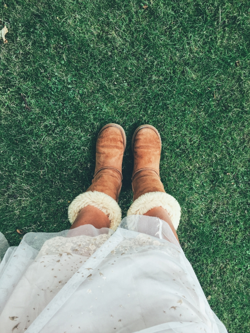 Winter boots and a dreamy dress on the grass