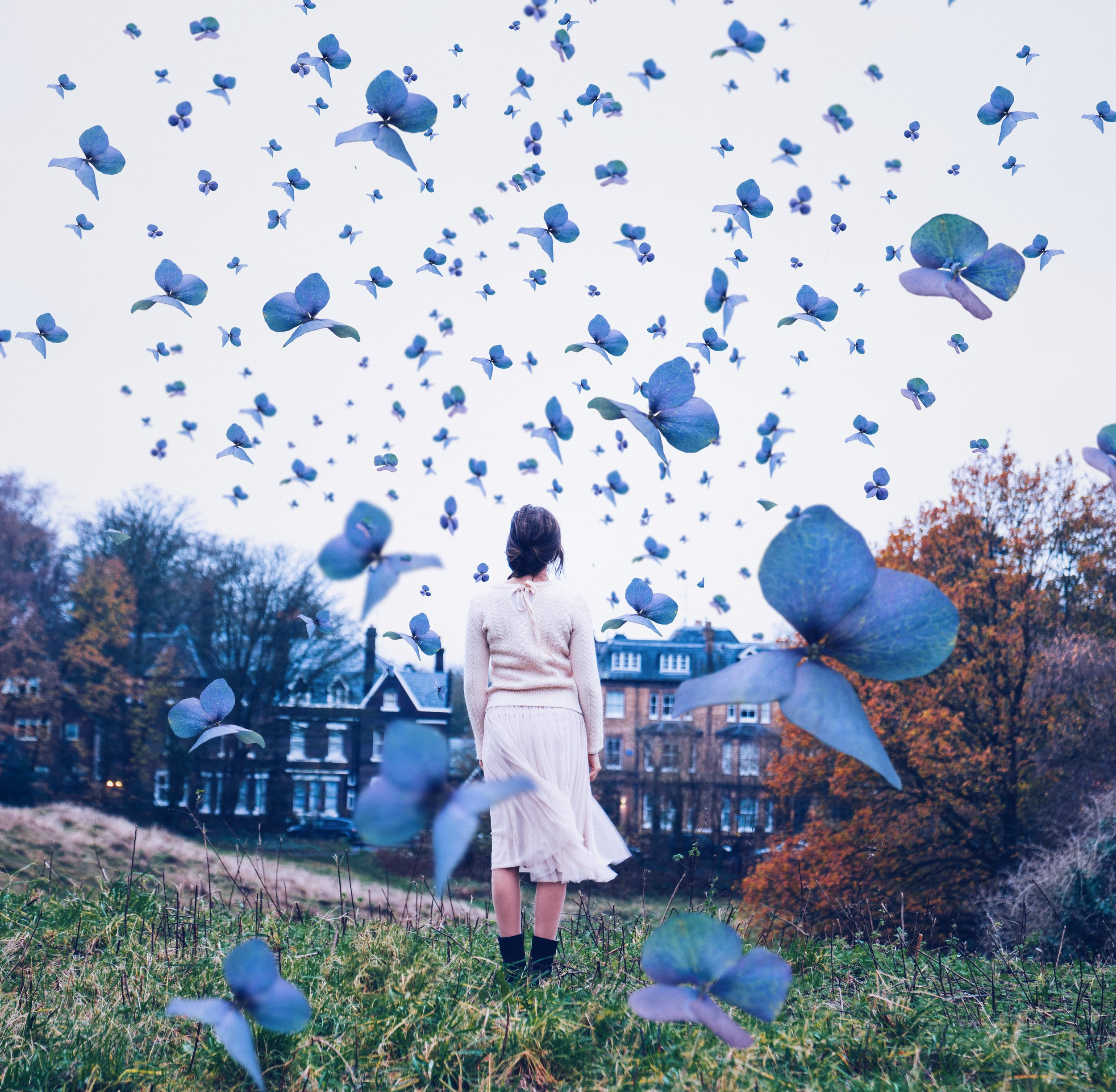 Youtube video with 5 tips How to get creative photo ideas for Instagram. Standing in a meadow of butterflies.