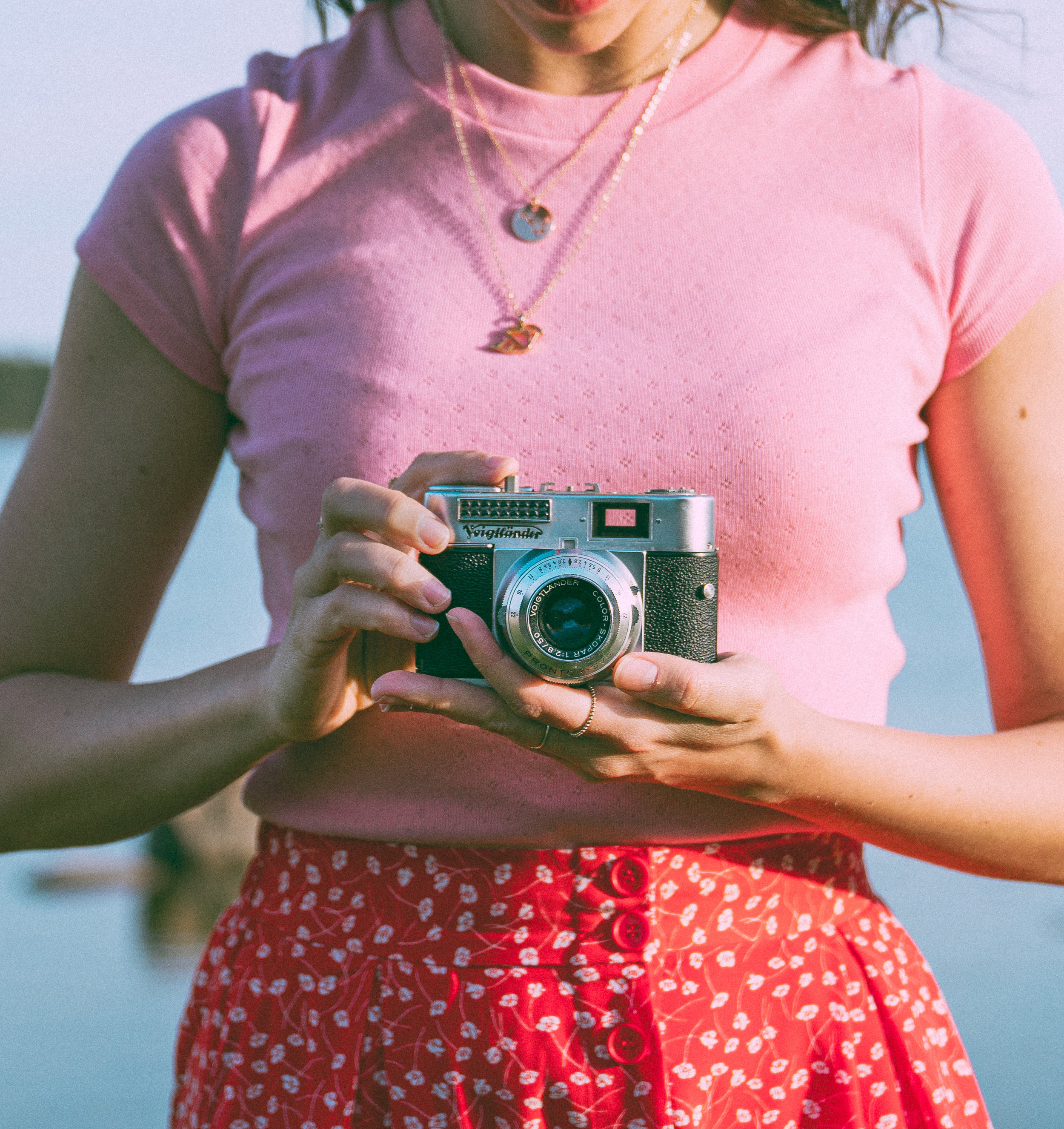 Old vintage camera selfie with pink retro top