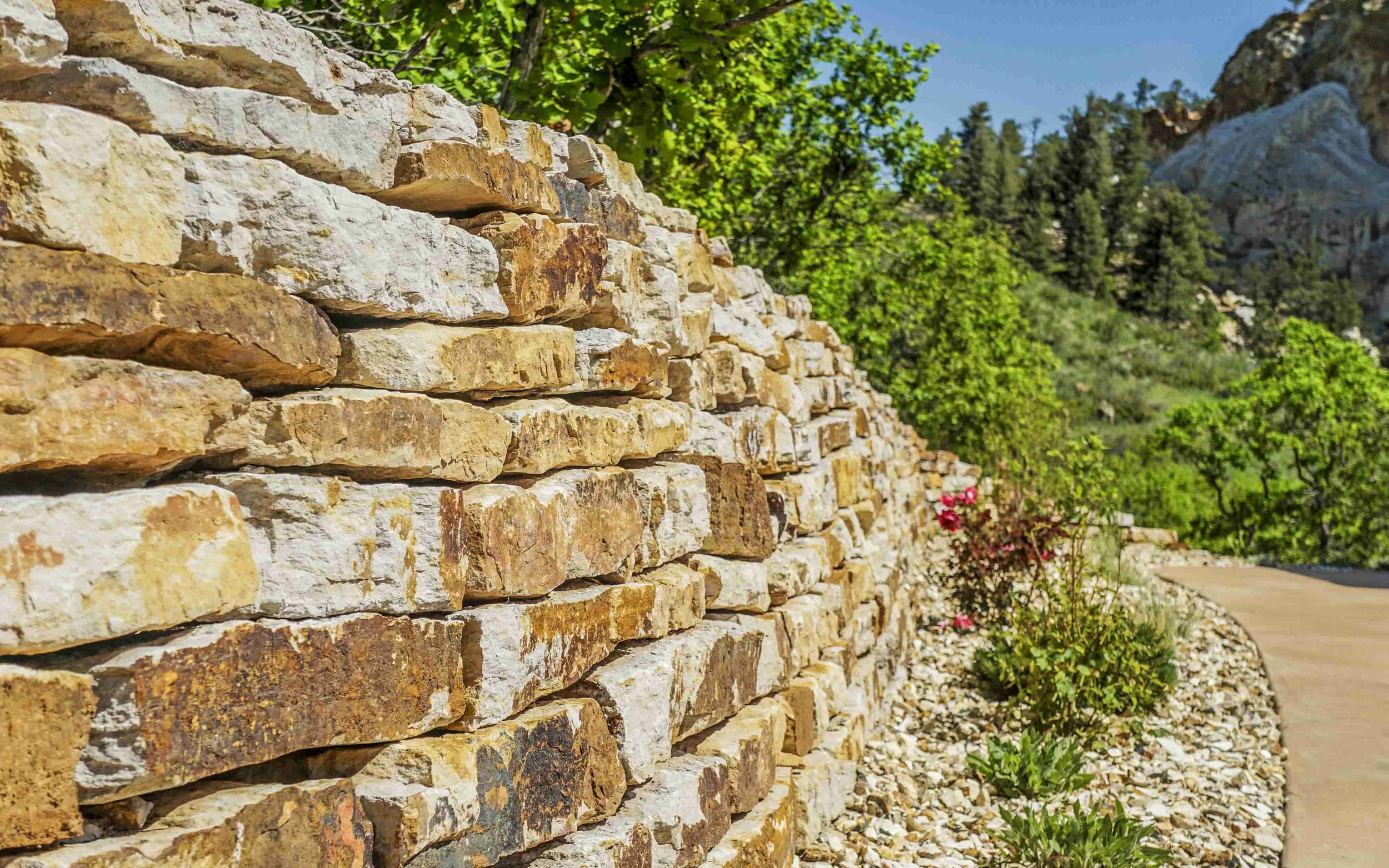 Retaining Walls - Retaining walls can be both beautiful and functional. Here at C&C, we have you covered with all options.