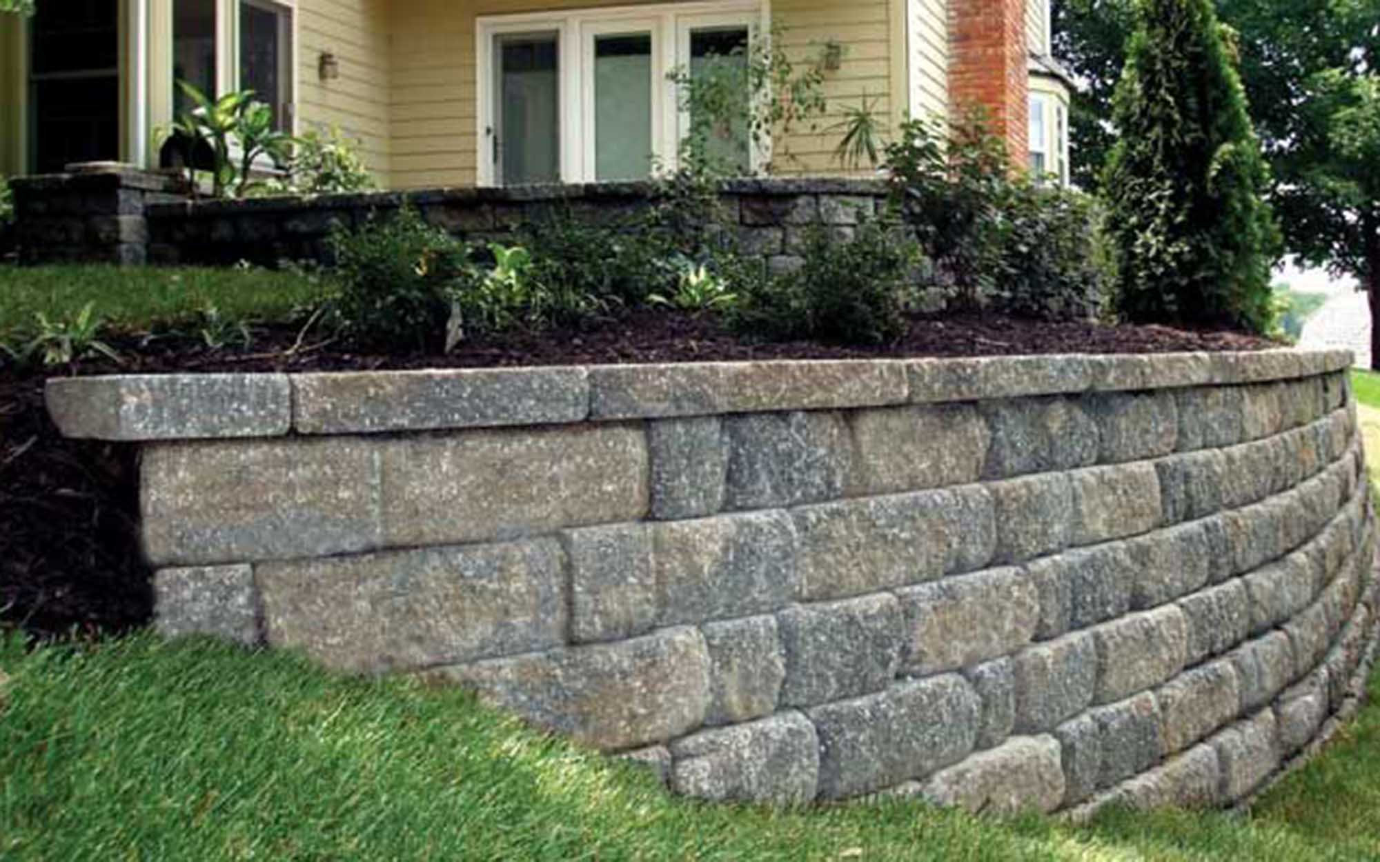 Keystone Hardscapes Retaining Walls - Pavestone retaining walls are functional and beautiful. Choose from many different colors.