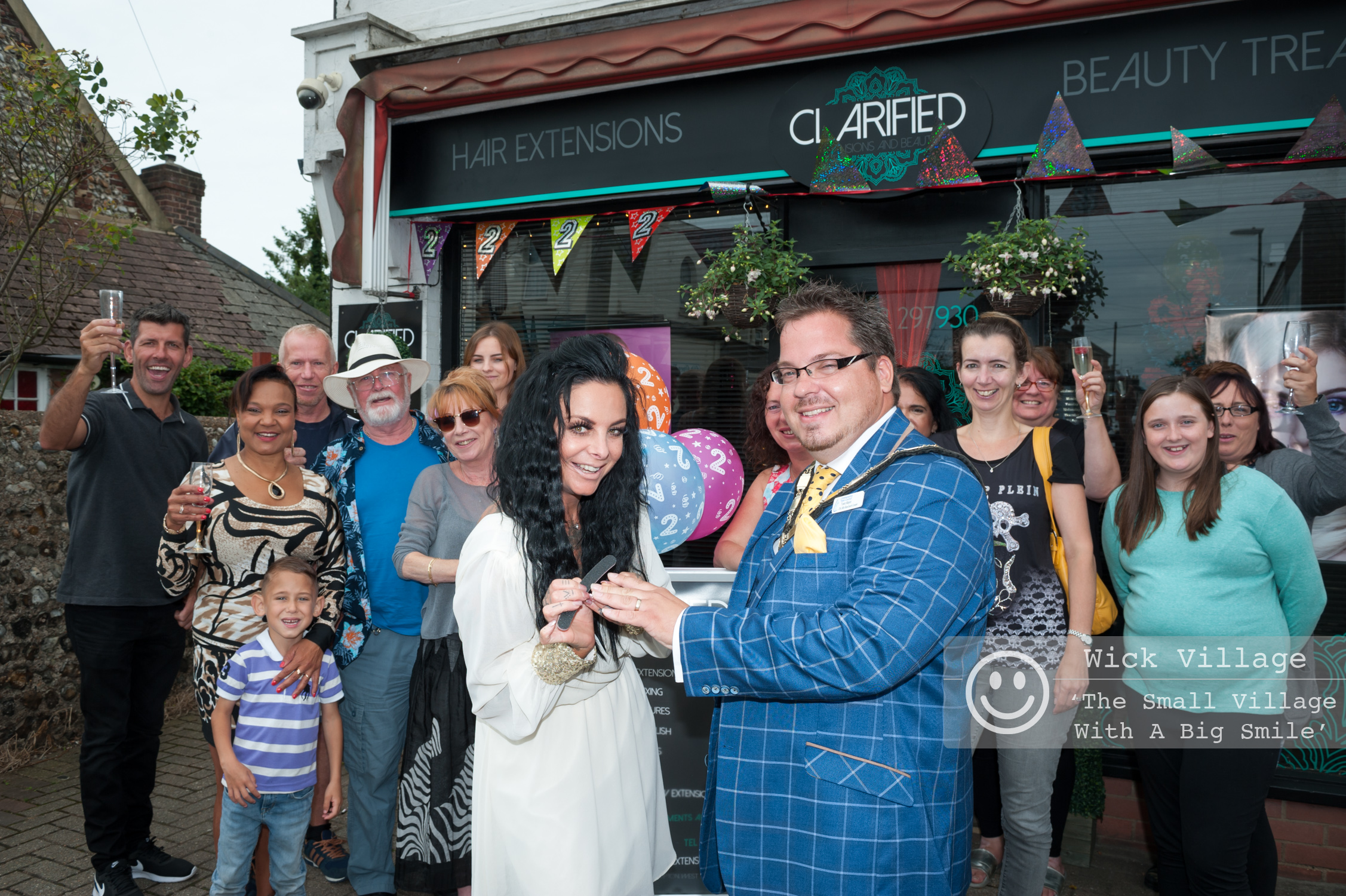 Clare Louise, owner of Clarified Extensions & Beauty, gives the Littlehampton Town Mayor, Councillor Billy Blanchard-Cooper, a quick manicure when he visits the salon during the celebrations.