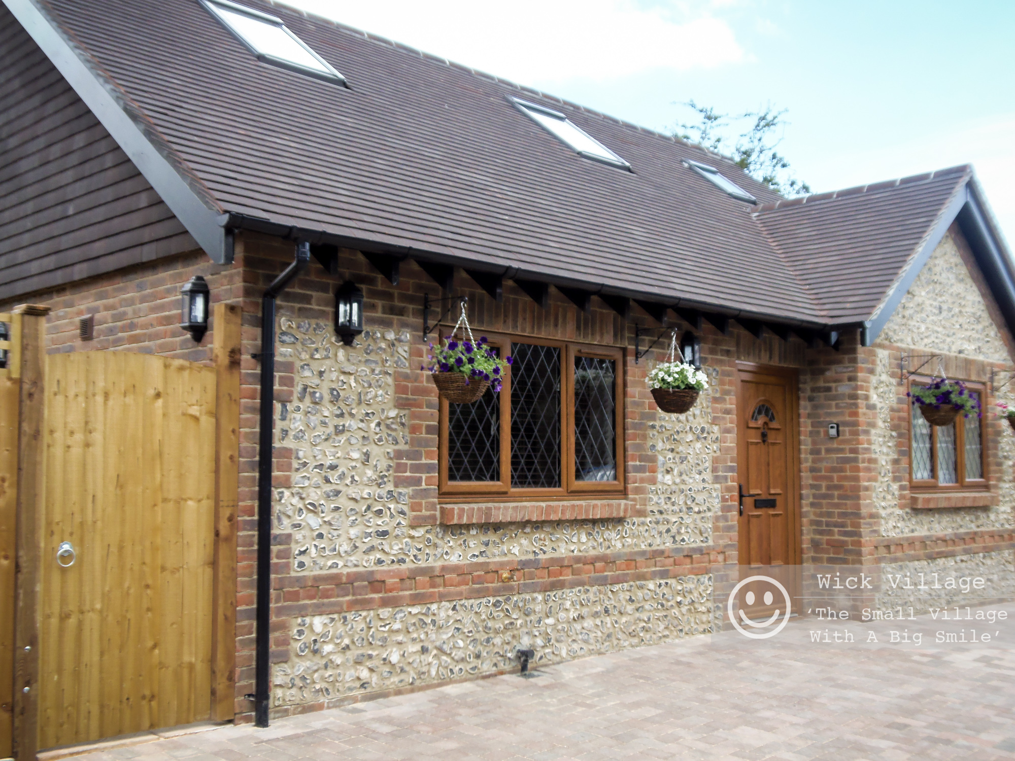 The exterior of Hunters Retreat Self-Catering Holiday Cottage in Lyminster, West Sussex.