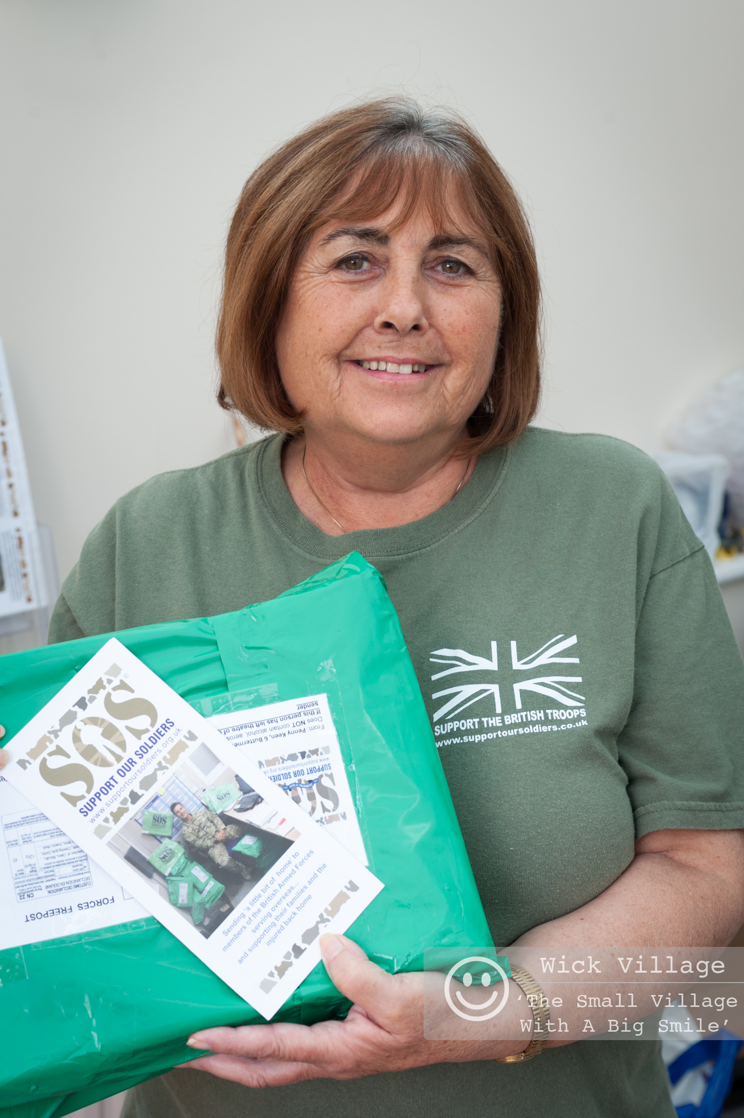 Penny Keen gets a parcel ready before sending it to a member of the British Armed Forces. Photo © Scott Ramsey/Wick Village Traders Association.