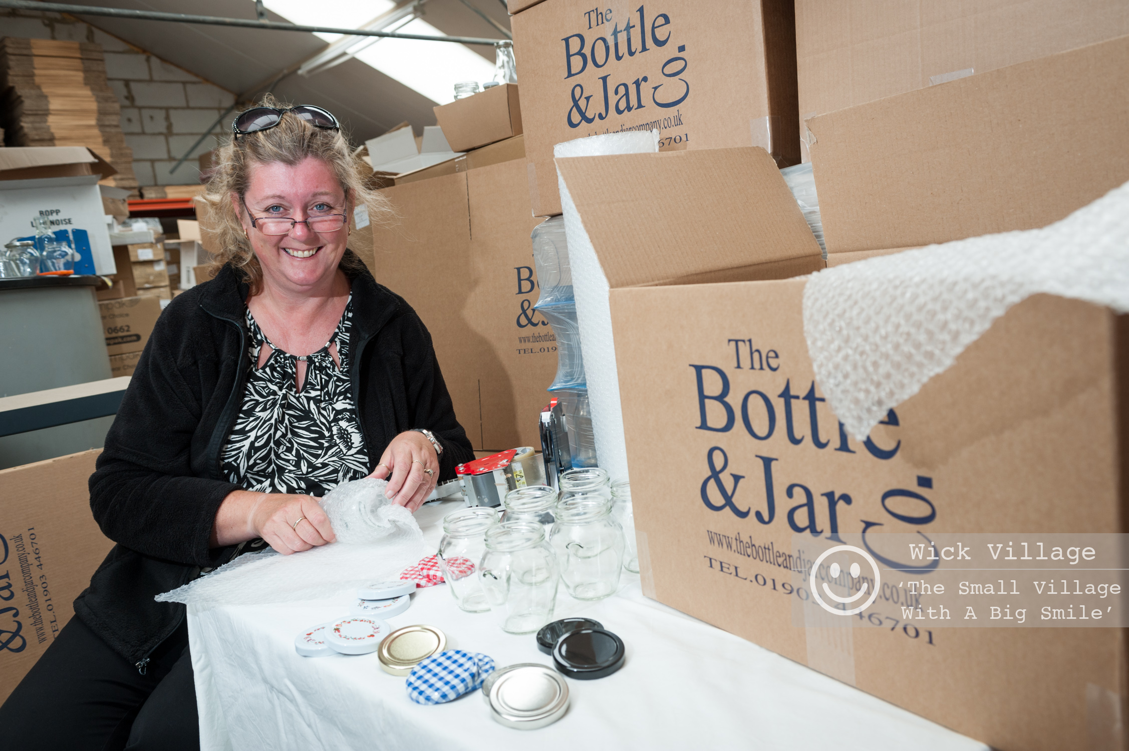 Kathy Vowles from The Bottle & Jar Company prepares an order of jars for a customer. Photo © Scott Ramsey/Wick Village Traders Association.