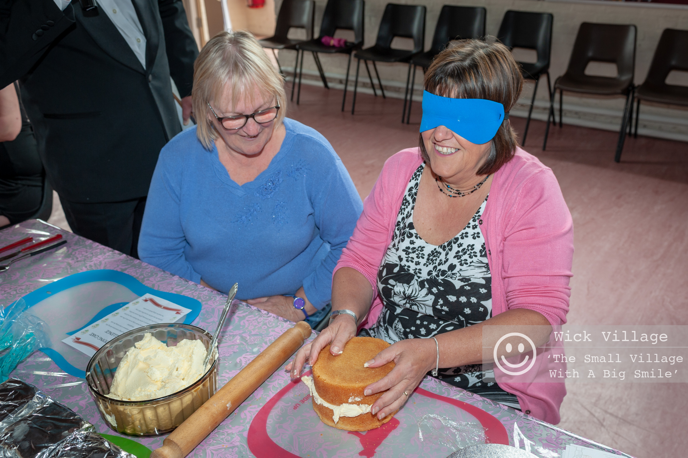 """Wick, Littlehampton, West Sussex, UK. 12th May 2018. Celebrations for the forthcoming royal wedding between Prince Harry and Meghan Markle started earlier in the village of Wick. Members of the local community and businesses held a fun royal wedding inspired challenge called """"The Royal Wedding Challenge Tea For Two"""" which saw local people and couples work together, either blindfolded or tied together, and complete wedding inspired challenges."""