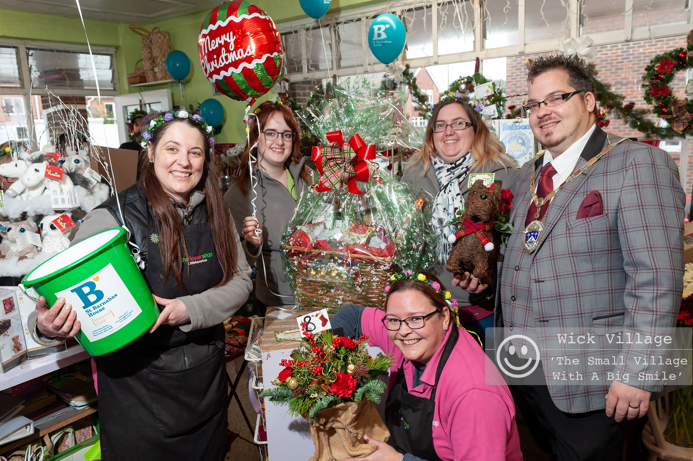 Staff at The Flower Shop in Wick Village raise funds for St Barnabas House during their annual Christmas Event at the florists in Wick Street. In Pic: The Mayor of Littlehampton, Councillor Billy Blanchard-Cooper with the staff of The Flower Shop. Photo ©  Scott Ramsey Sussex PR Photographer