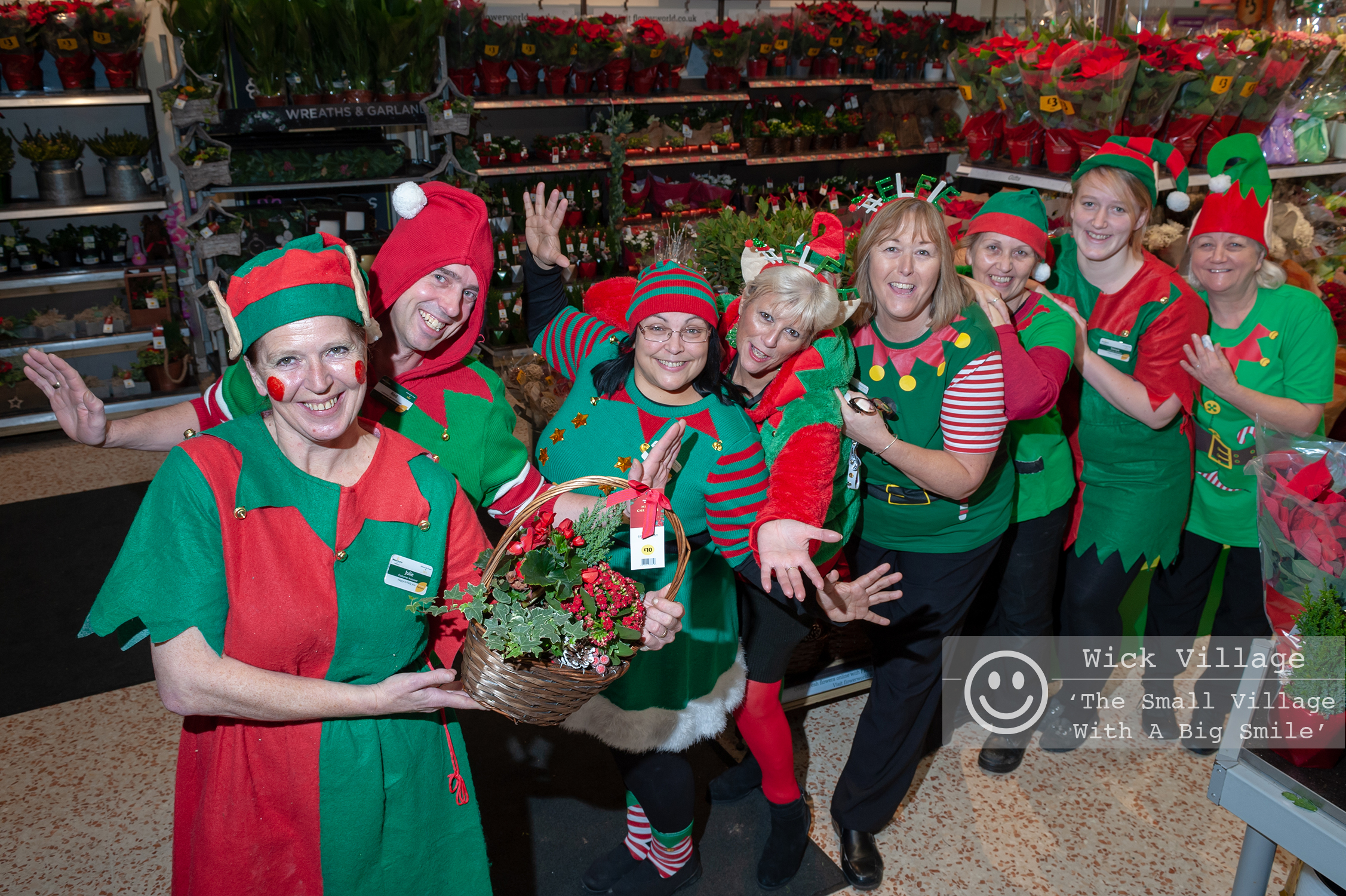 Staff at the Morrisons store in Littlehampton dress up as Elves to raise money for charity. Photo ©  Scott Ramsey Sussex Editorial Photographer .