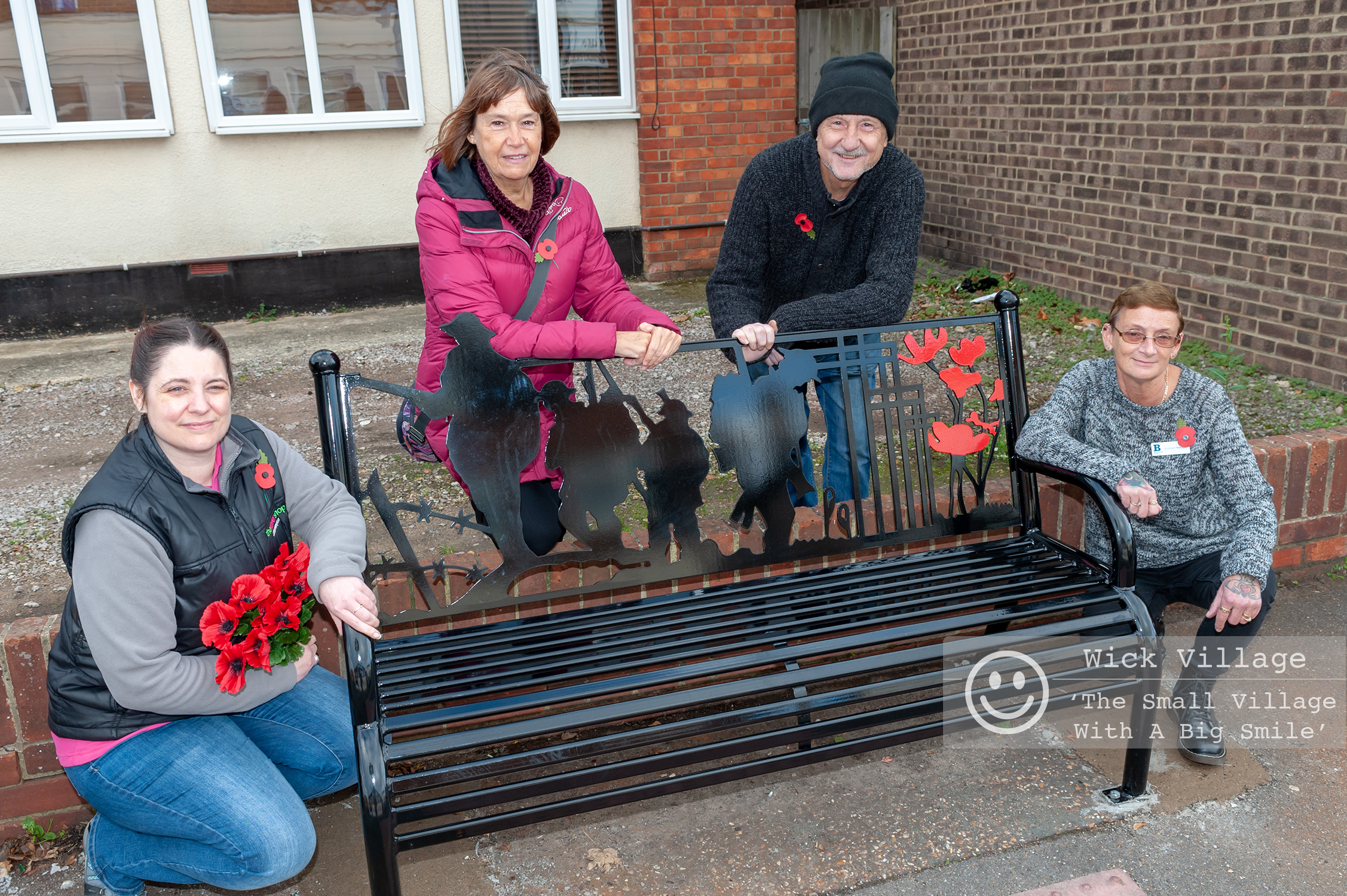 The Wick Village Traders Association have funded a new bench in Wick Village to mark the centenary of the end of the First World War. In Pic: Standing next to the new bench on Wick Street are left to right - Michelle Bly, Head Designer at The Flower Shop Littlehampton, Julie Roby, Wick Information Centre and Wick Hall Manager, Roger Arthurs, Owner of Going Spare, and Jan O'Sullivan, Assistant Manager at The St Barnabas House Charity Shop. Photo © Scott Ramsey  Littlehampton Photographer .